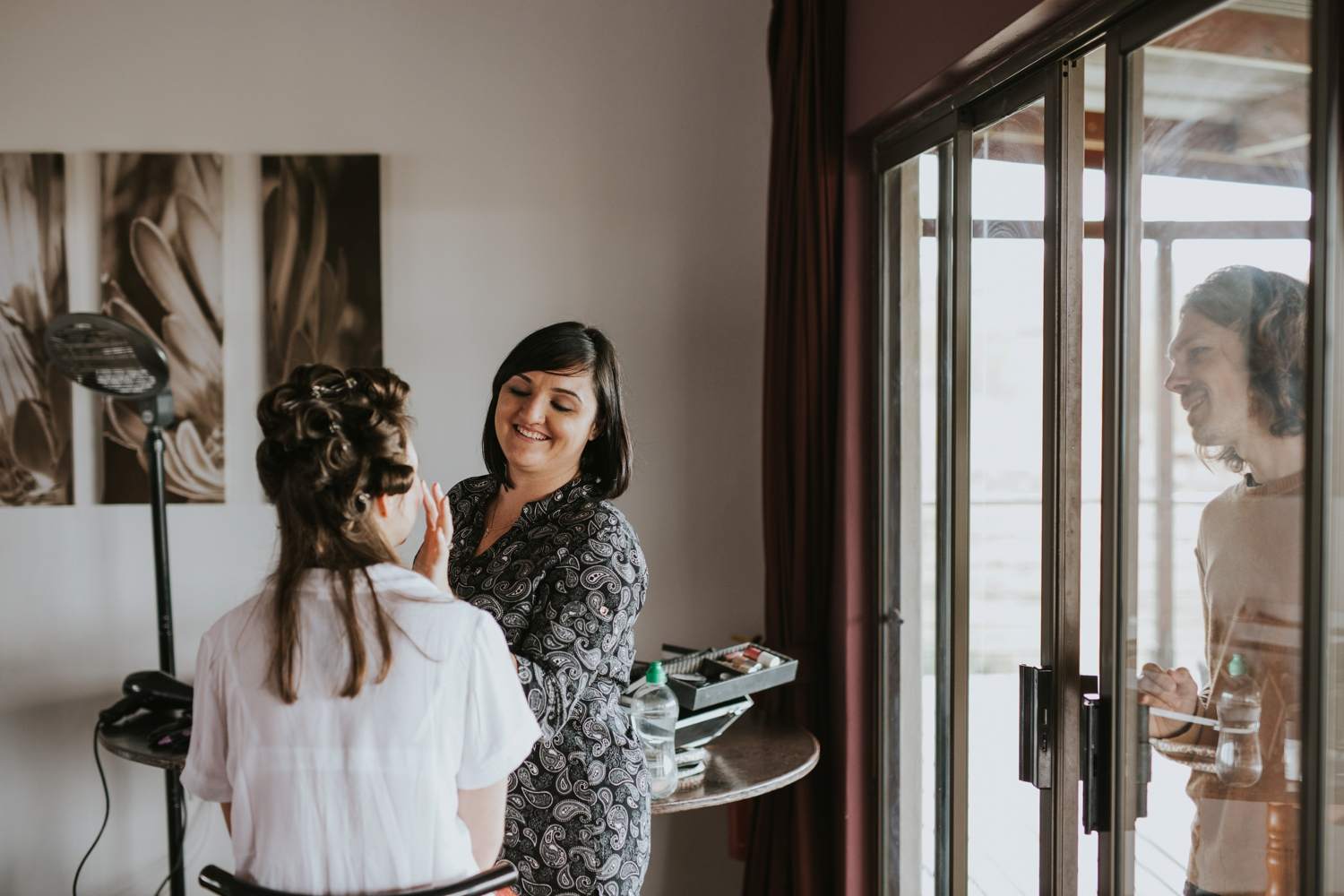 Bride's Brother Looking Through The Window As She Gets Her Makeup Done At Cecil Green Park House Wedding In Vancouver