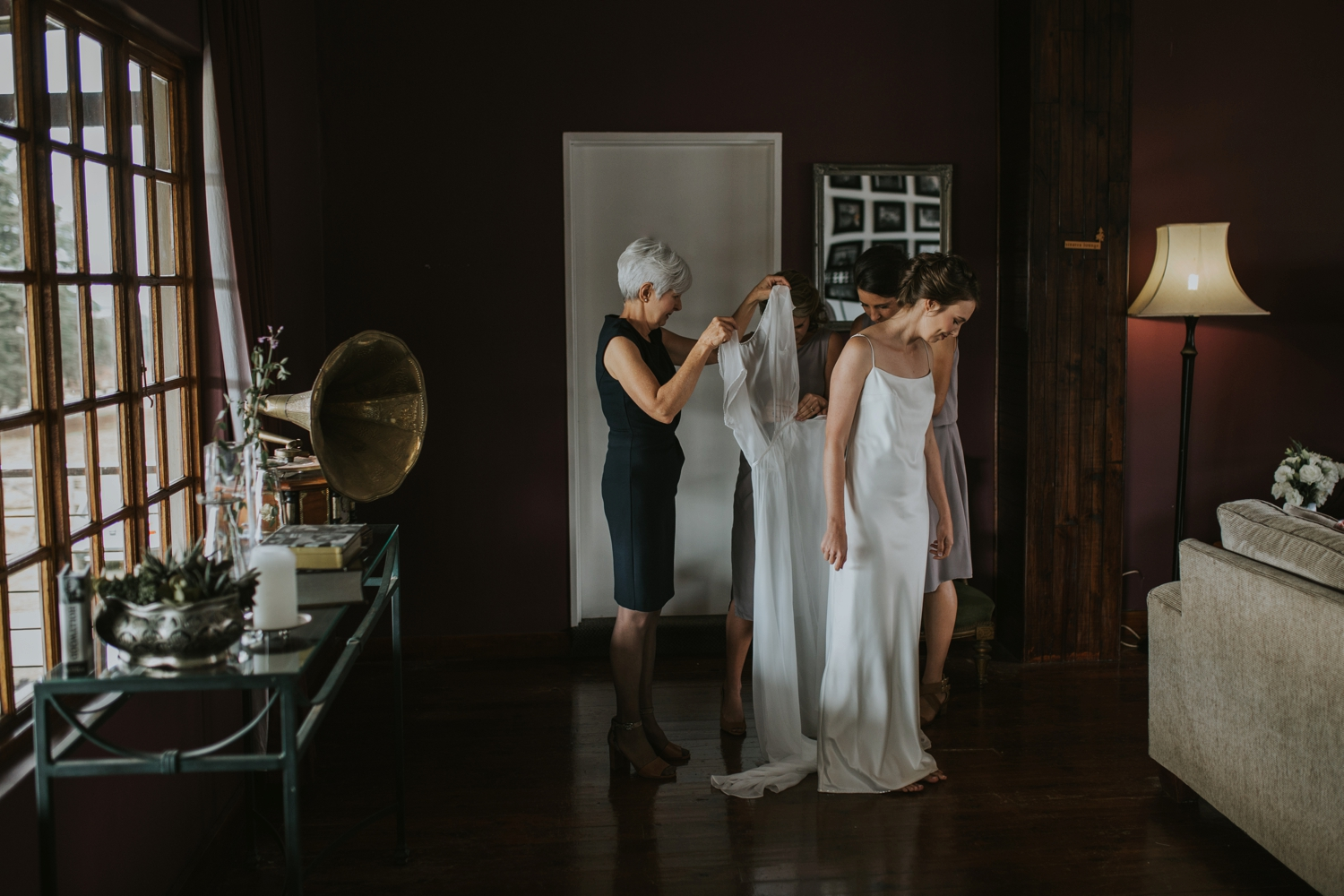 Mom Helping Bride Get Dressed In Simple Elegant Classic Layered Wedding Dress