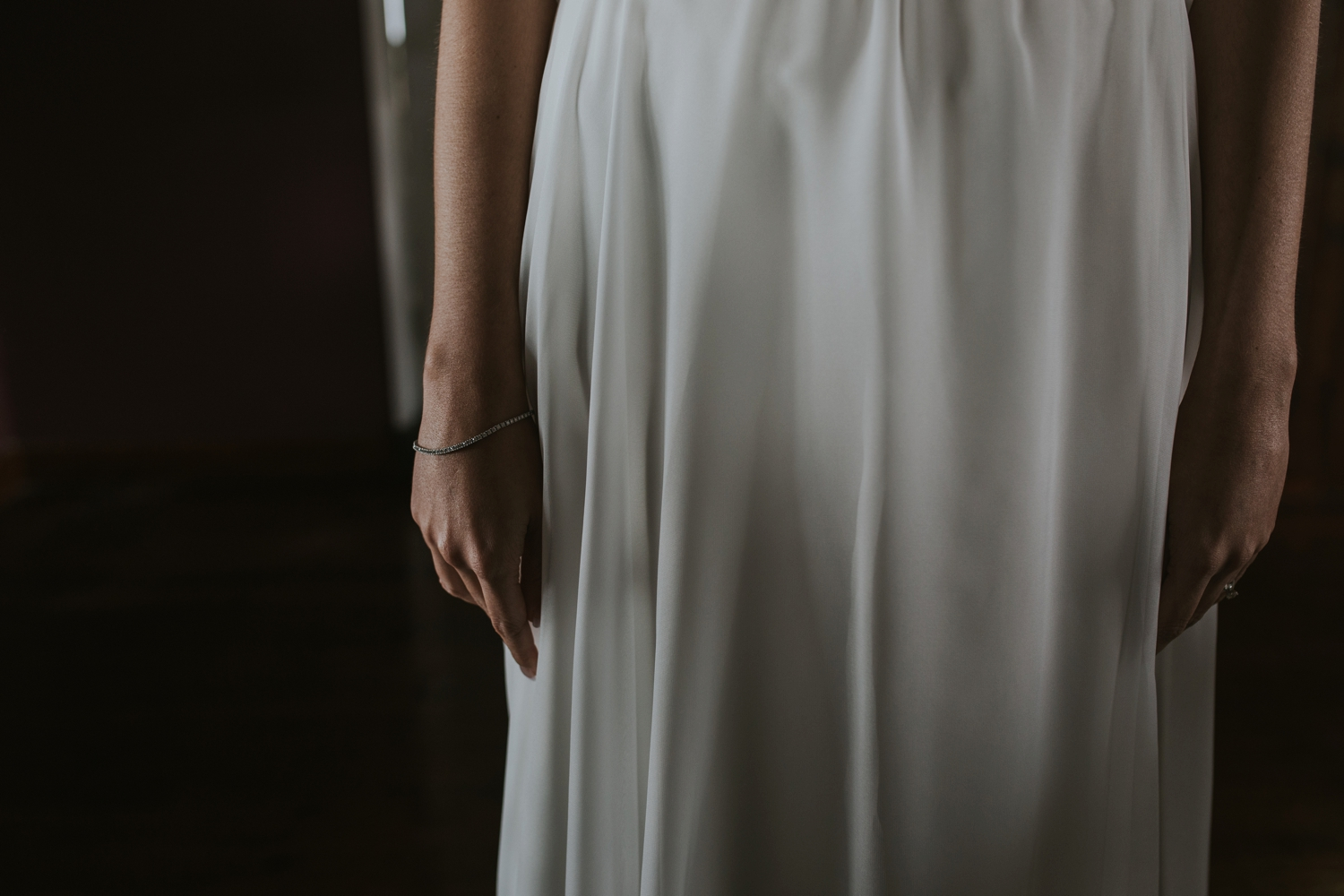 Bride is wearing simple, elegant, cream, silk wedding dress at Cecil Green Park House, Vancouver Wedding Venue.