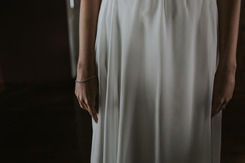 Bride is wearing simple, elegant, cream, silk wedding dress at Cecil Green Park House, Vancouver Wedding Venue.