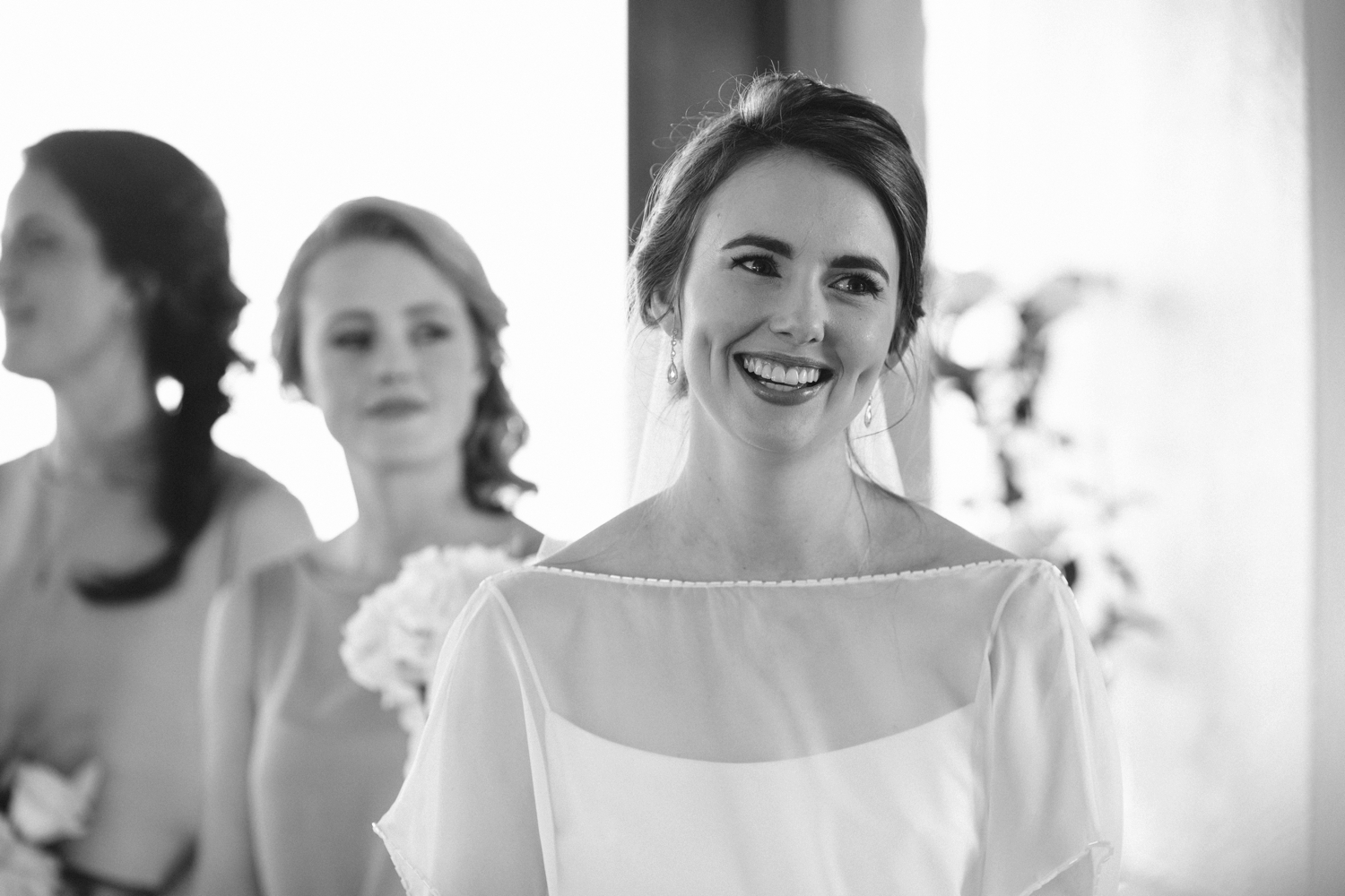 Documentary wedding photography of bride looking at groom and laughing during Vancouver wedding ceremony