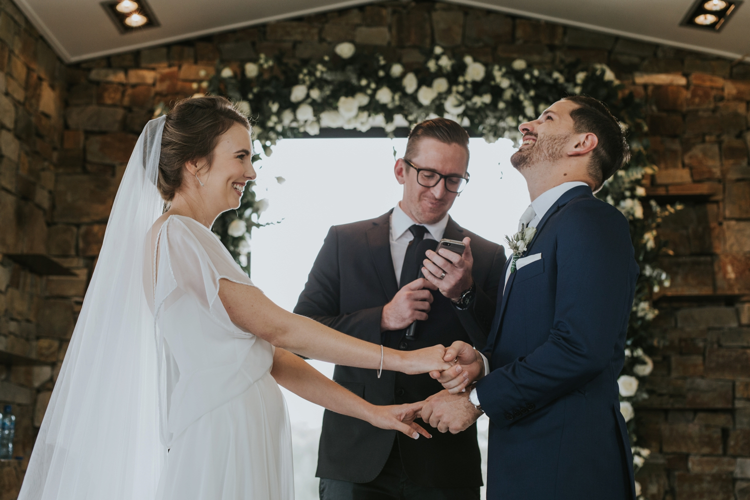 Bride and groom laughing together in Vancouver wedding ceremony
