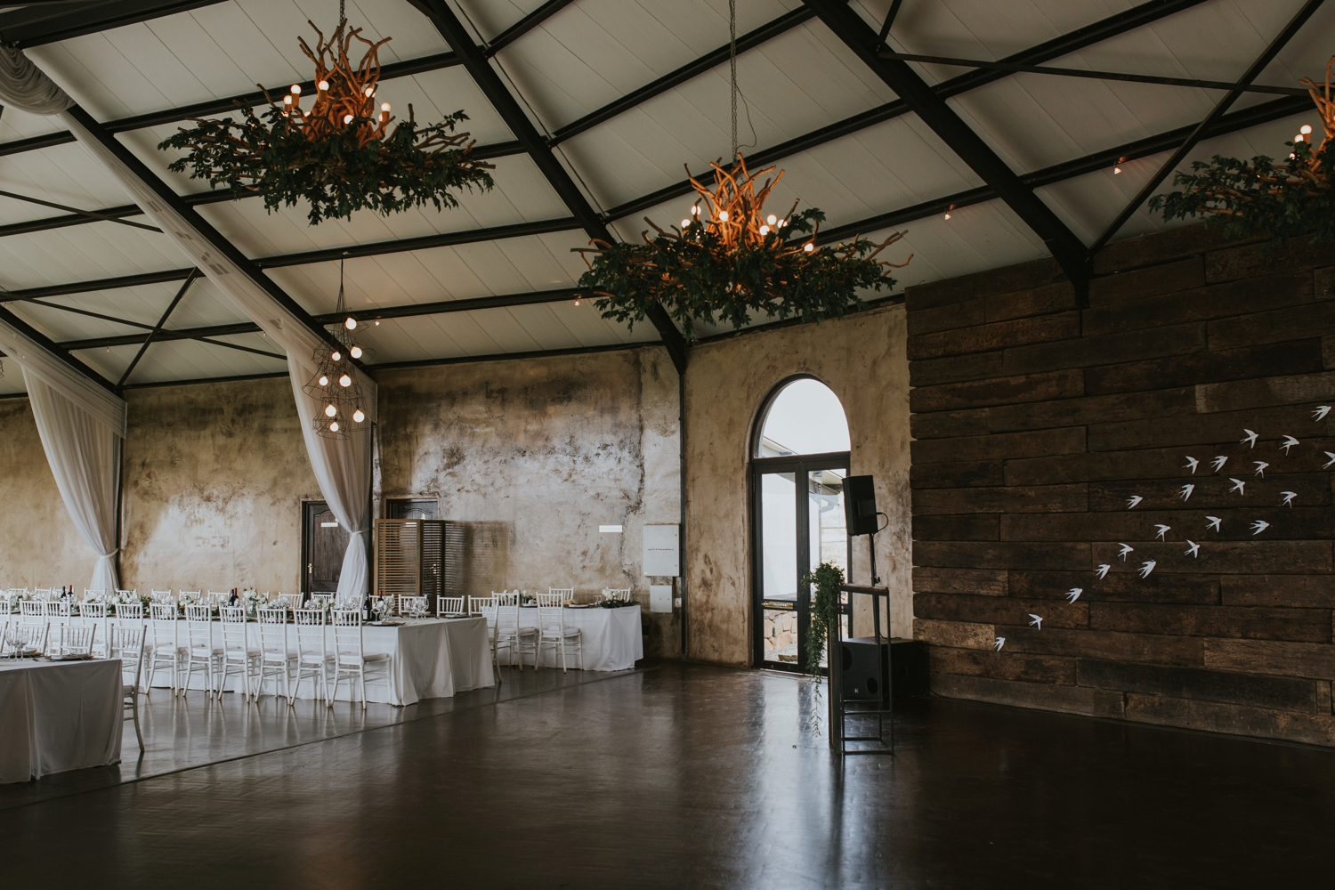 Simple, elegant wedding reception with white and simple greenery at The Pipe Shop Shipyards in North Vancouver