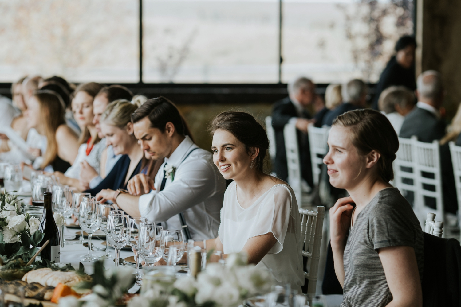 Bride with wedding guests at casual, simple, classic wedding lunch in Vancouver