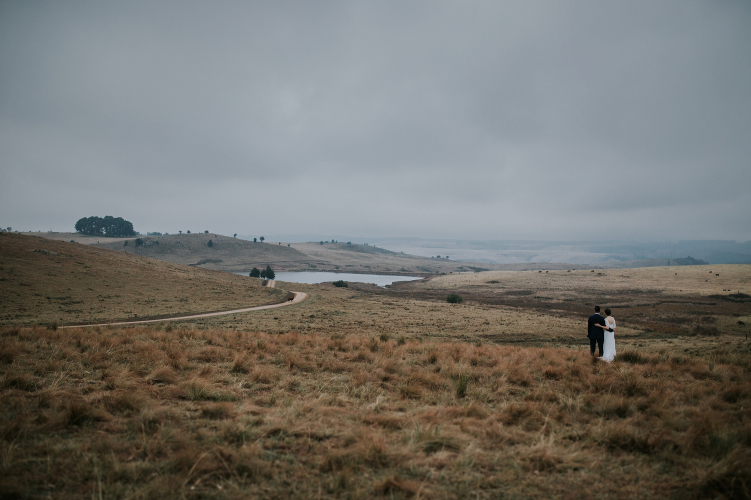 Bride and groom look at epic landscape view during wedding photography session in Vancouver