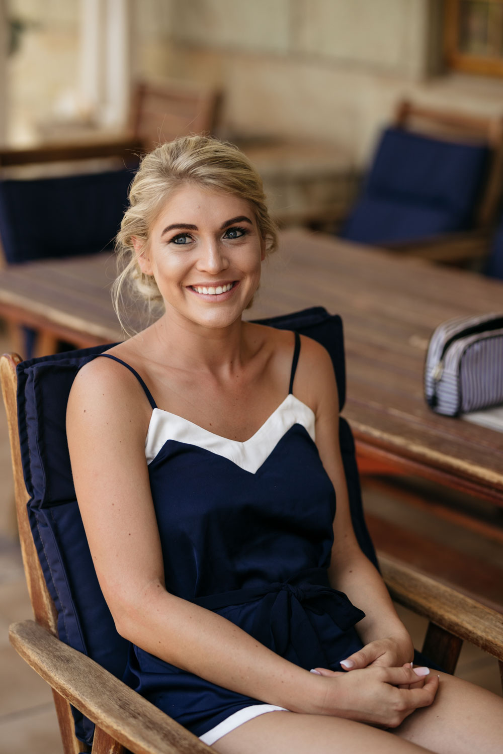Blonde Bride Wearing Cute Blue And White Playsuit For Getting Ready Photographs