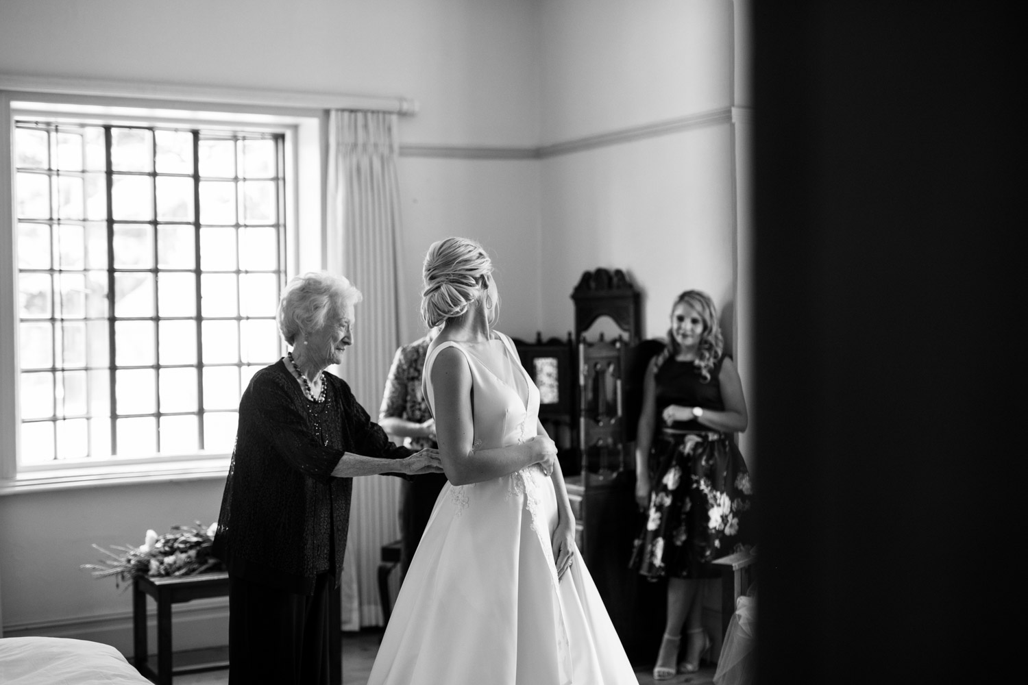 Grandmother Helps Bride Get Into Her Silk White Simple Classic Wedding Dress With Pockets