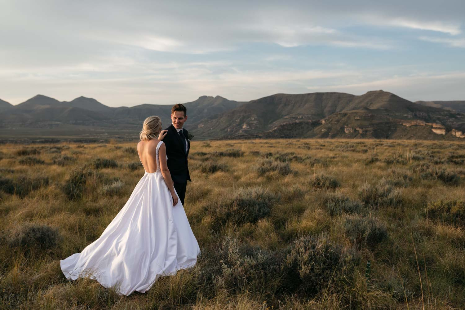 Epic Wedding Photo Of Bride And Groom In Golden Field Overlooking Mountains In Vancouver Whistler