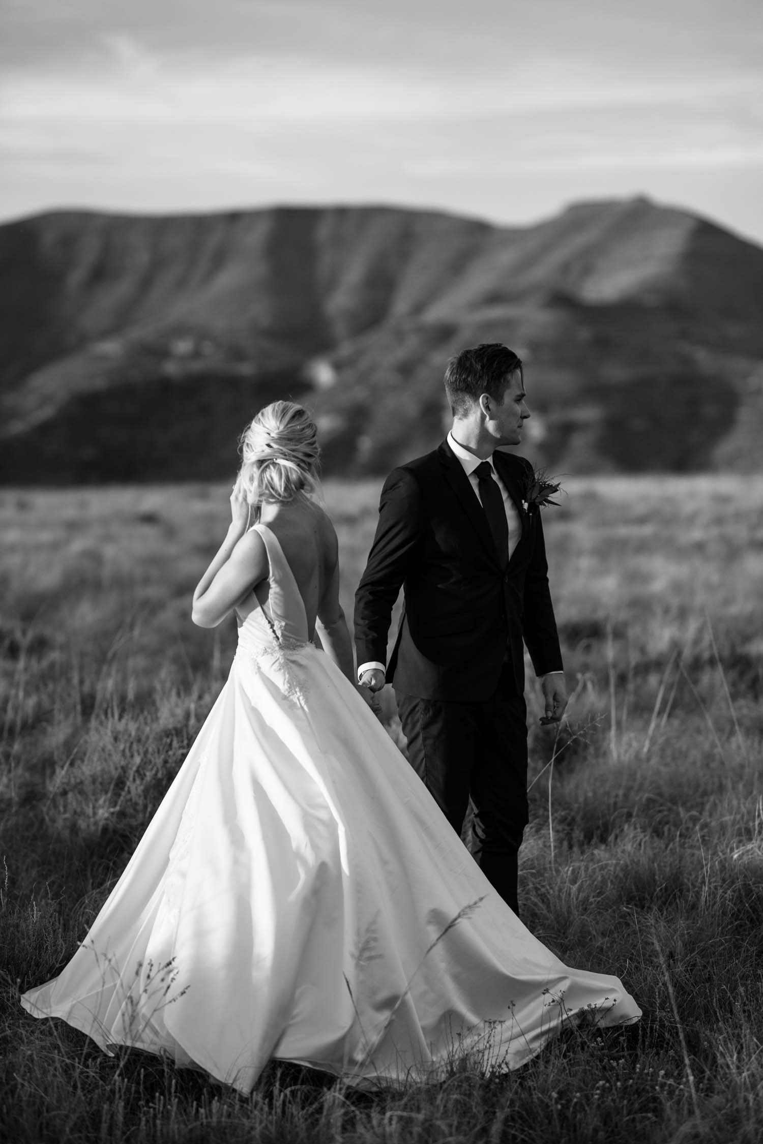 Epic Black And White Photo Bride And Groom In Field In Rocky Mountains