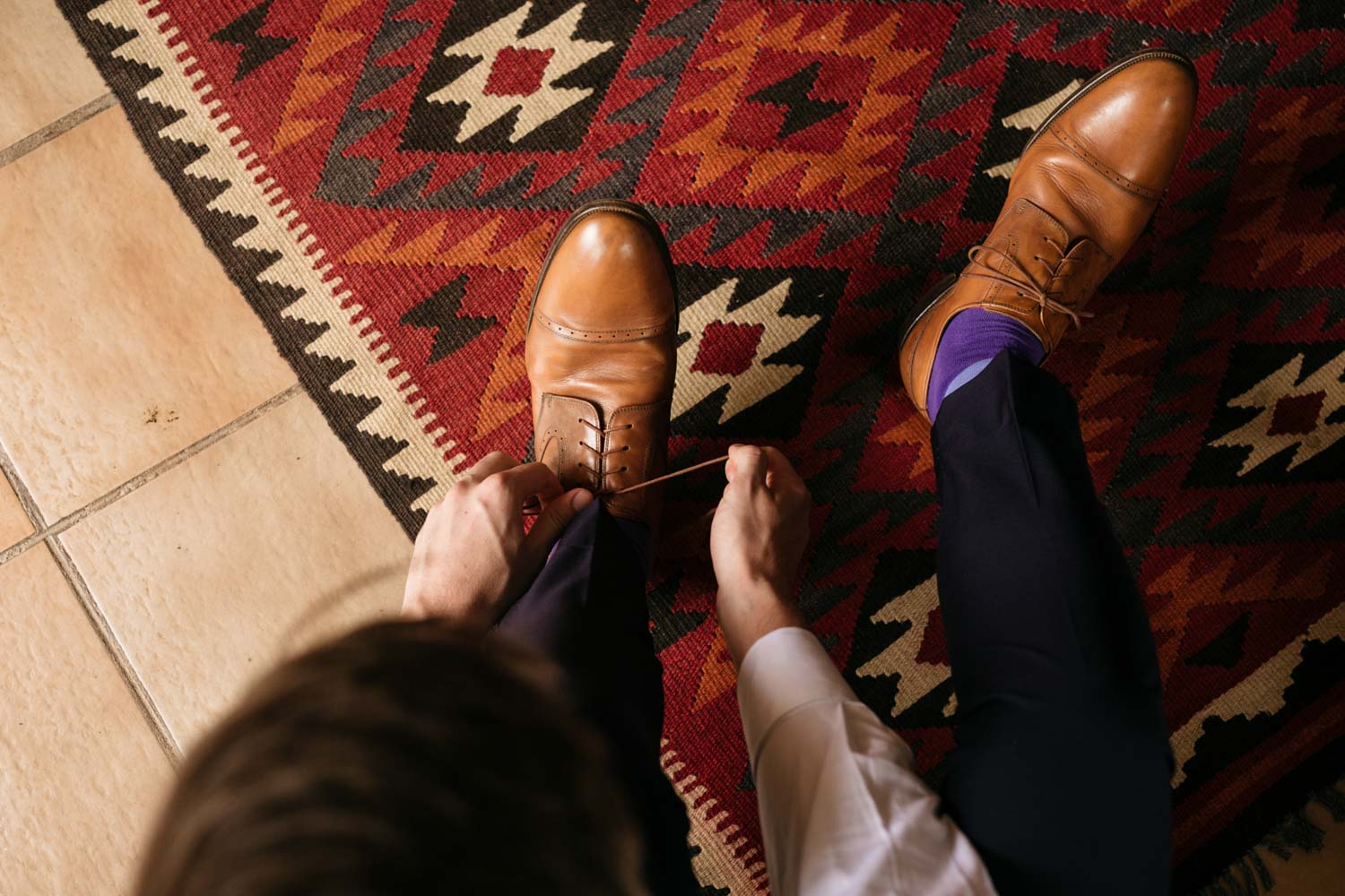 Groom Puts On Light Brown Leather Wedding Shoes