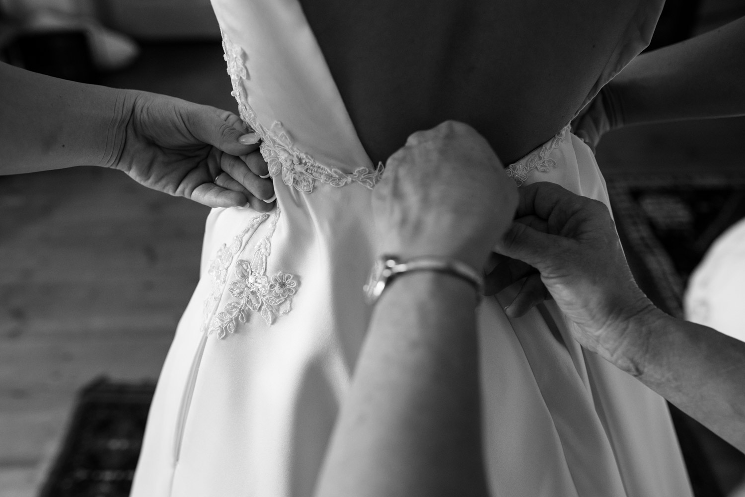 Mother Of Brides Helps Daughter Into Trendy Lace And Silk Wedding Dress With Pockets