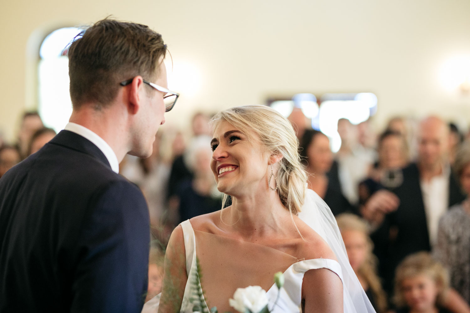 Emotional Candid Wedding Moment At Top Of Aisle Between Bride And Groom