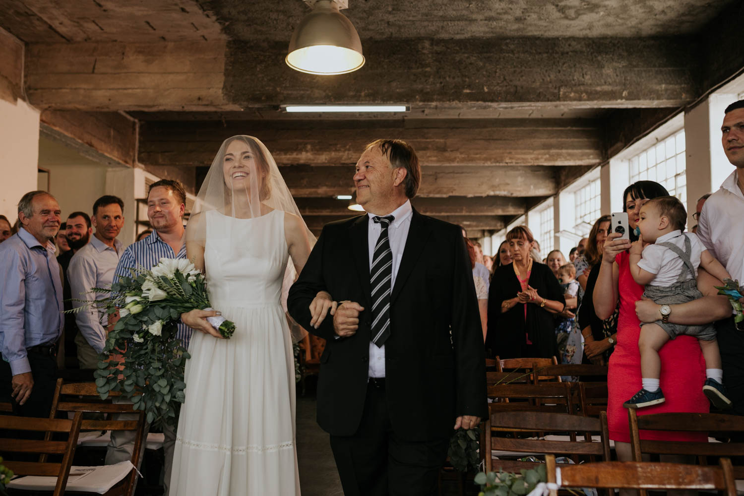 Bride Holding Simple White And Olive Green Wedding Bouquet Walks Down Aisle With Father