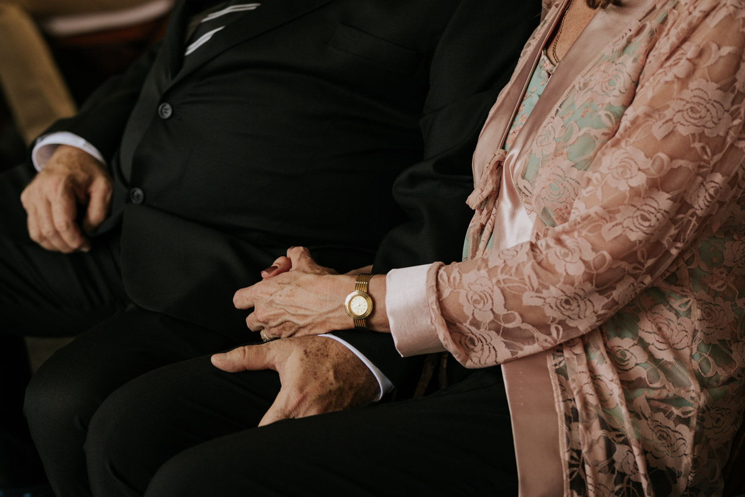 Parents Of Groom Share Moment And Holds Hands In Wedding Ceremony