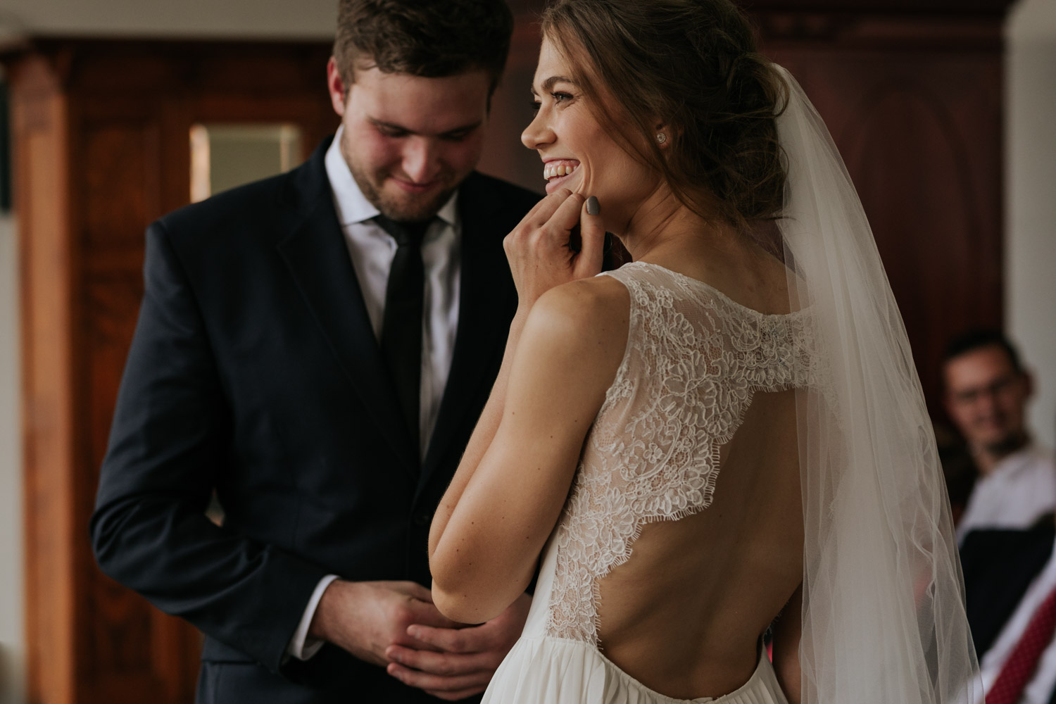 Bride Wears Trending Simple Lace Wedding Dress with Round Cut Out At Back Of Dress