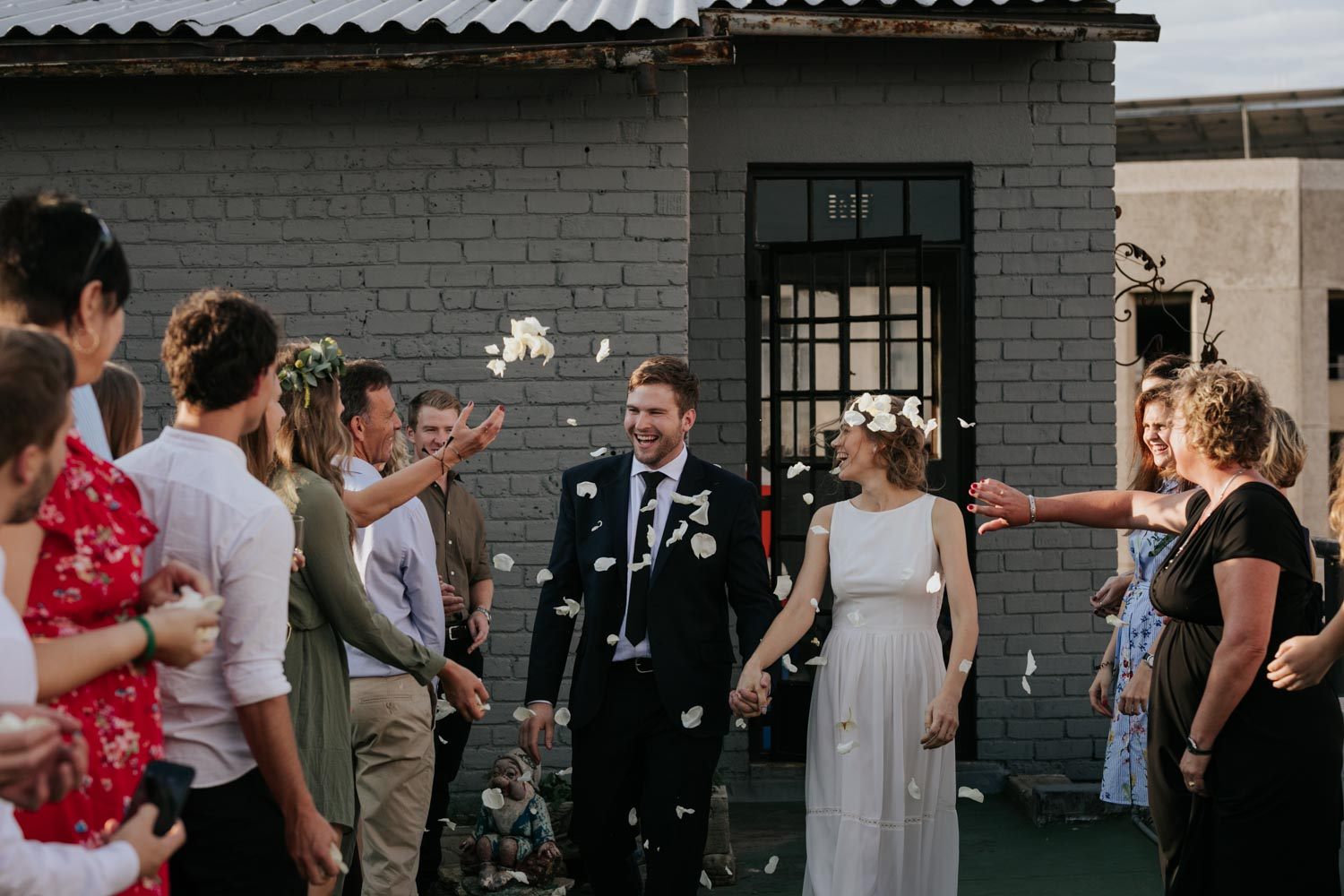 White Rose Petal Confetti Throw On Roof Of Vancouver City Wedding Venue