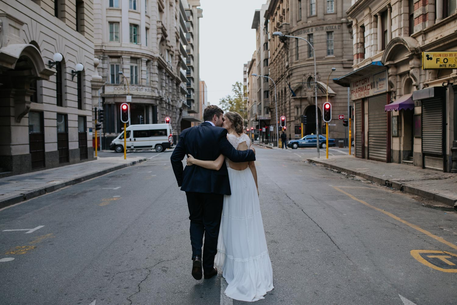 Bride And Groom Walk Down Vancouver City Streets Kissing
