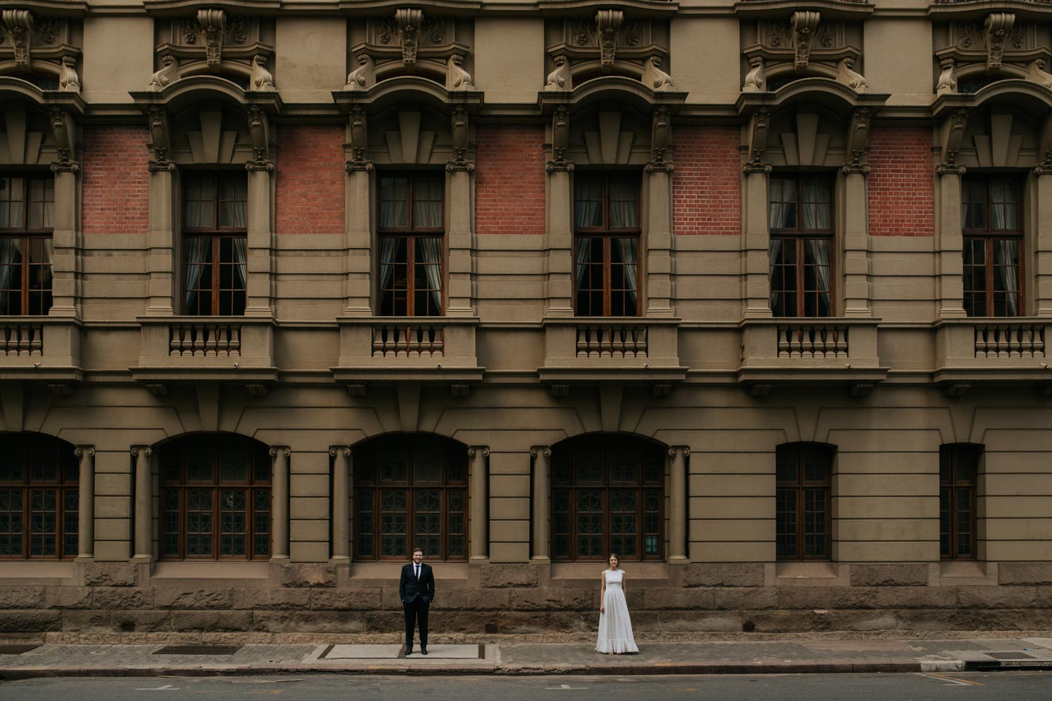 Wedding Couple In Front Of Epic Old Vancouver Heritage Building