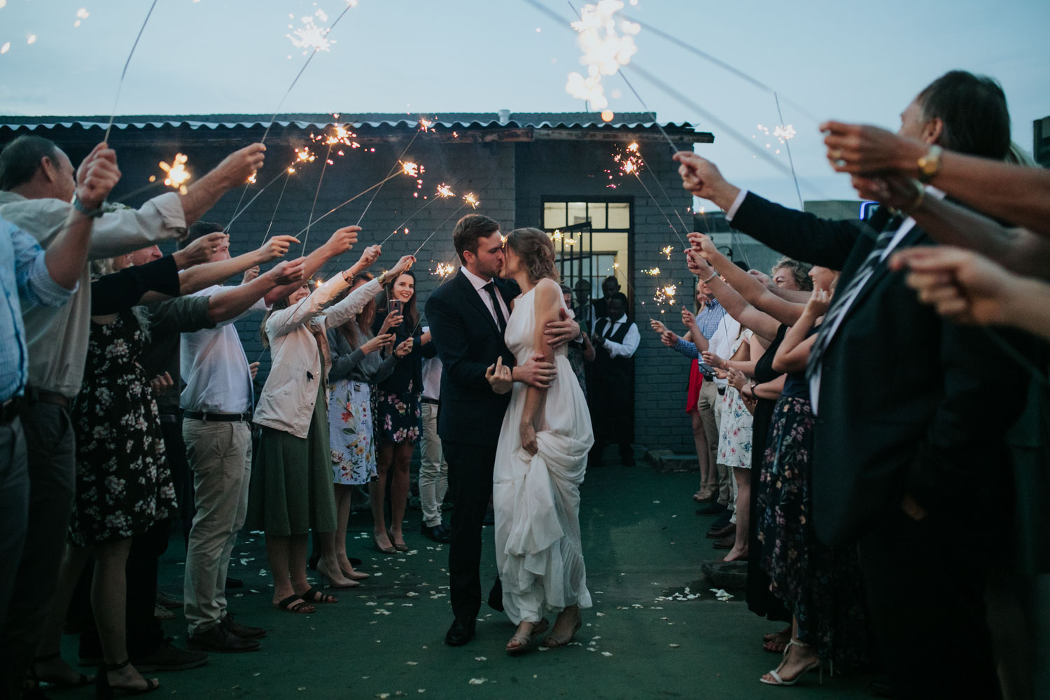 Bride And Groom Kiss In Sparkler Entrance Wedding Photo In Gastown Vancouver