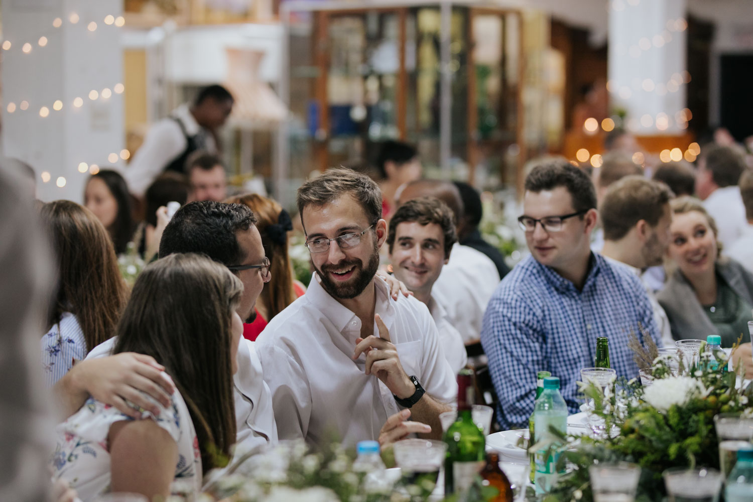 Candid Photo Of Guests Chatting During Wedding Dinner Feast