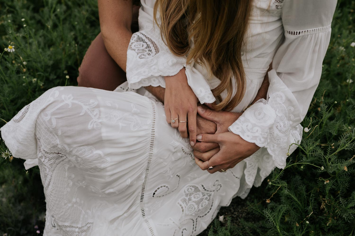 Boho Bride And Groom Hold Each Other in Camomile Field at Babylonstoren Cape Town Wedding Venue