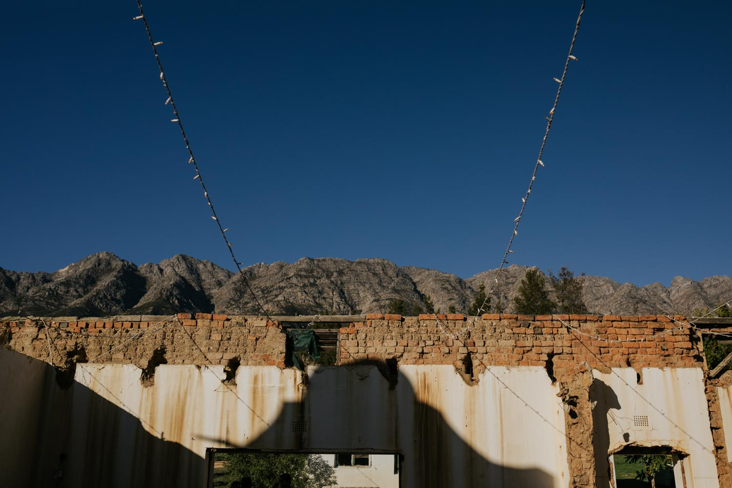 Wedding held in the ruins of an old farm house in the Tulbagh mountains close to Riebeek Kasteel and Cape Town.