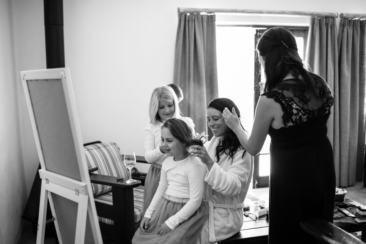 Candid moment of natural bride and flower girls getting ready in Tulbagh, near Cape Town