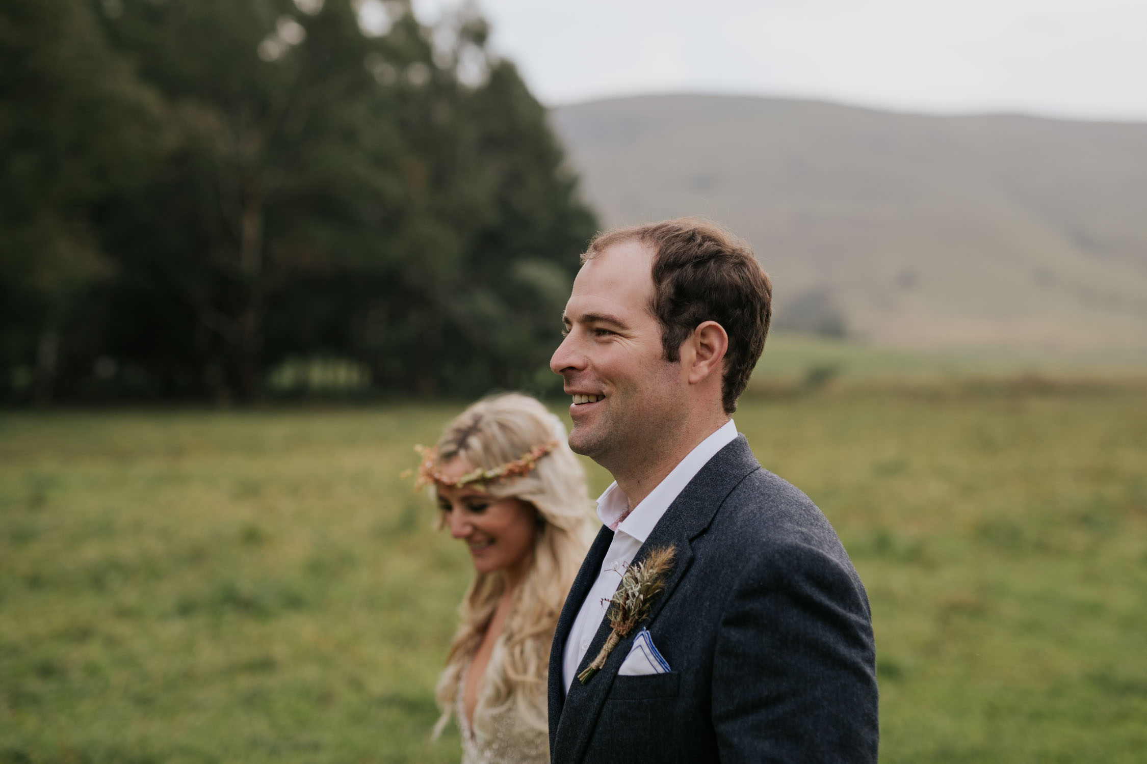Bride and groom surrounded by green hills and fields at a farm wedding venue in the Natal Midlands near Nottingham Road.