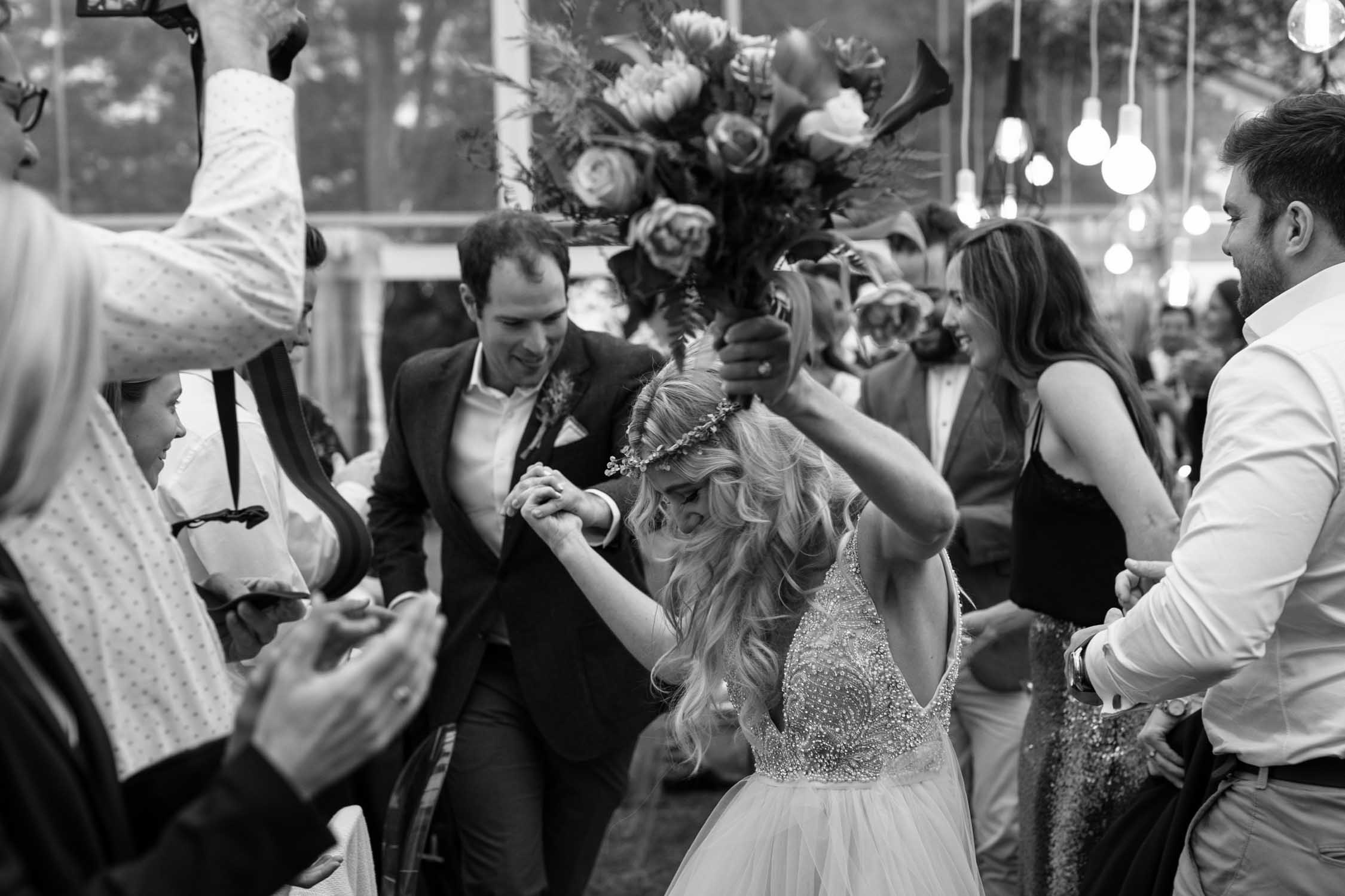 Bride and groom dancing into their wedding reception held in the Natal Midlands near Notthingham Road.
