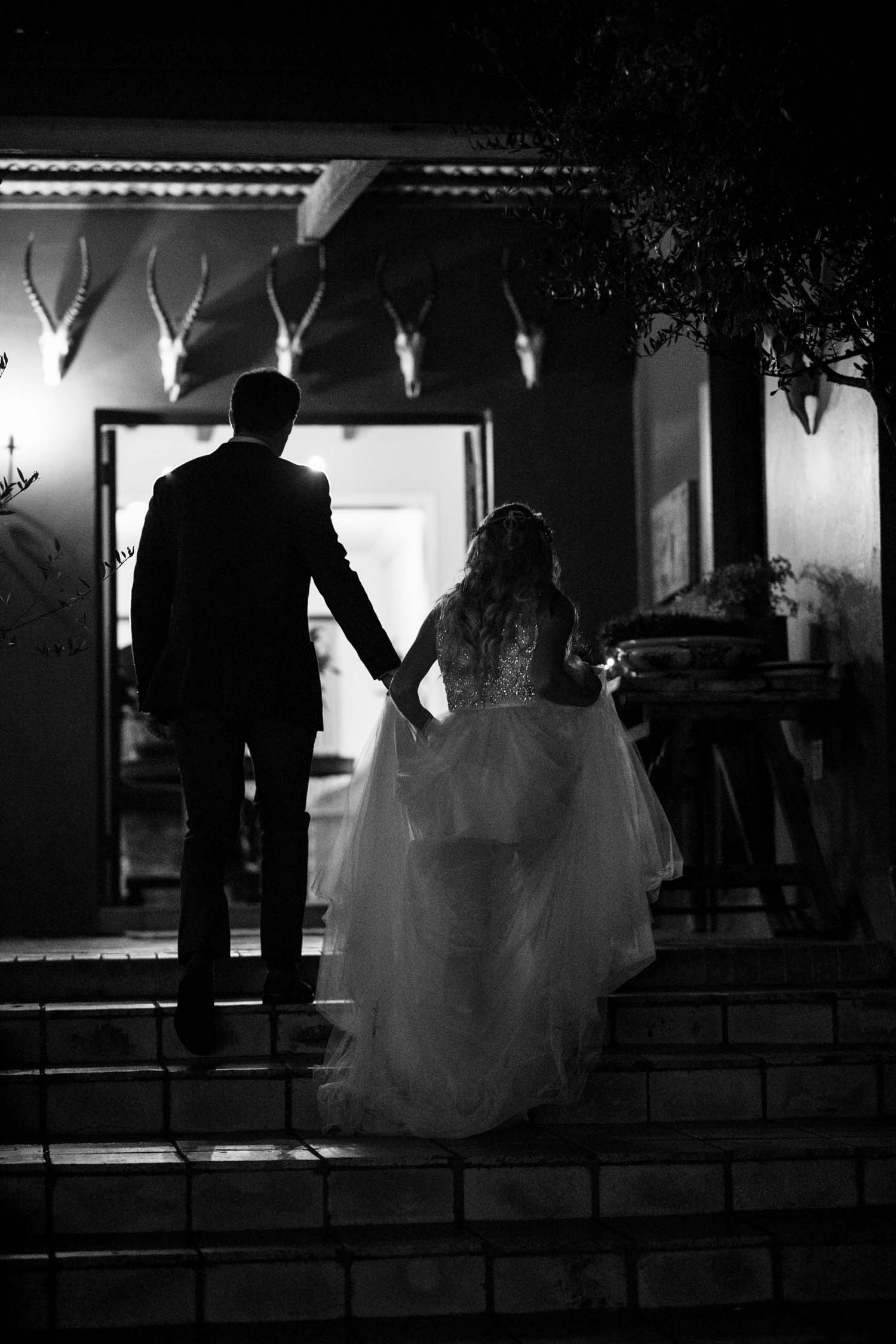 Night shot of bride and groom on stairs
