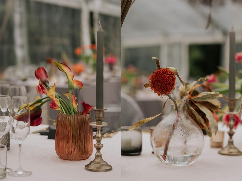 Simplistic wedding flowers and grey candles on velvet table cloth. Wedding decor.