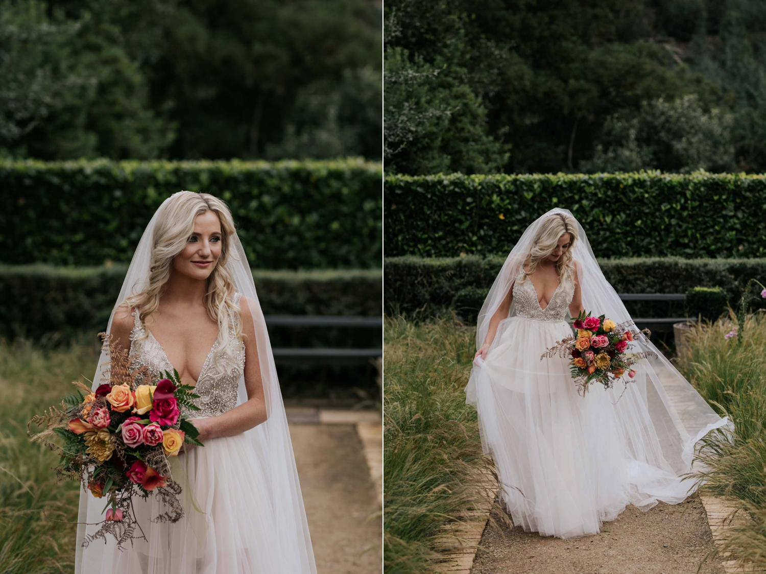 Bride walking down garden path on farm wearing a low cut dress with beautiful and detailed beadwork with a skirt that is see through and cute shorts underneath almost like a jump suit underneath a wedding dress. She is holding a wedding bouquet of burnt orange pink and red flowers and roses with dried ferns and grass in it.