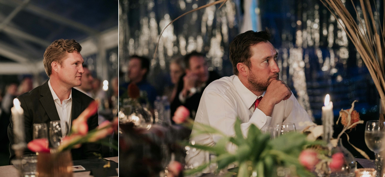 Candid and emotional photographs of guests enjoying themselves and laughing during a wedding reception and during speeches.