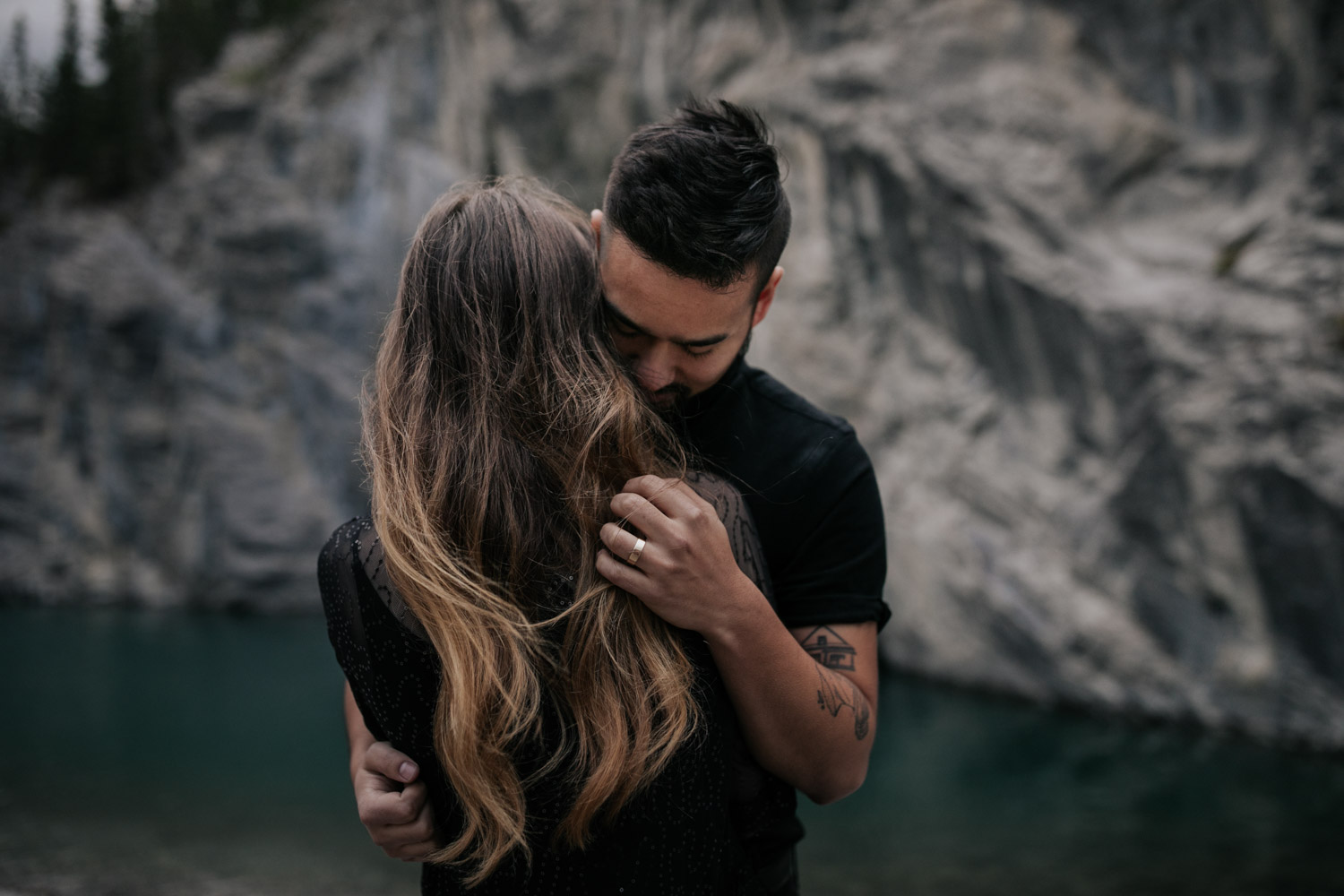 Romantic Boho Couple Dressed In Black At Turquoise Blue Lake In Banff Alberta