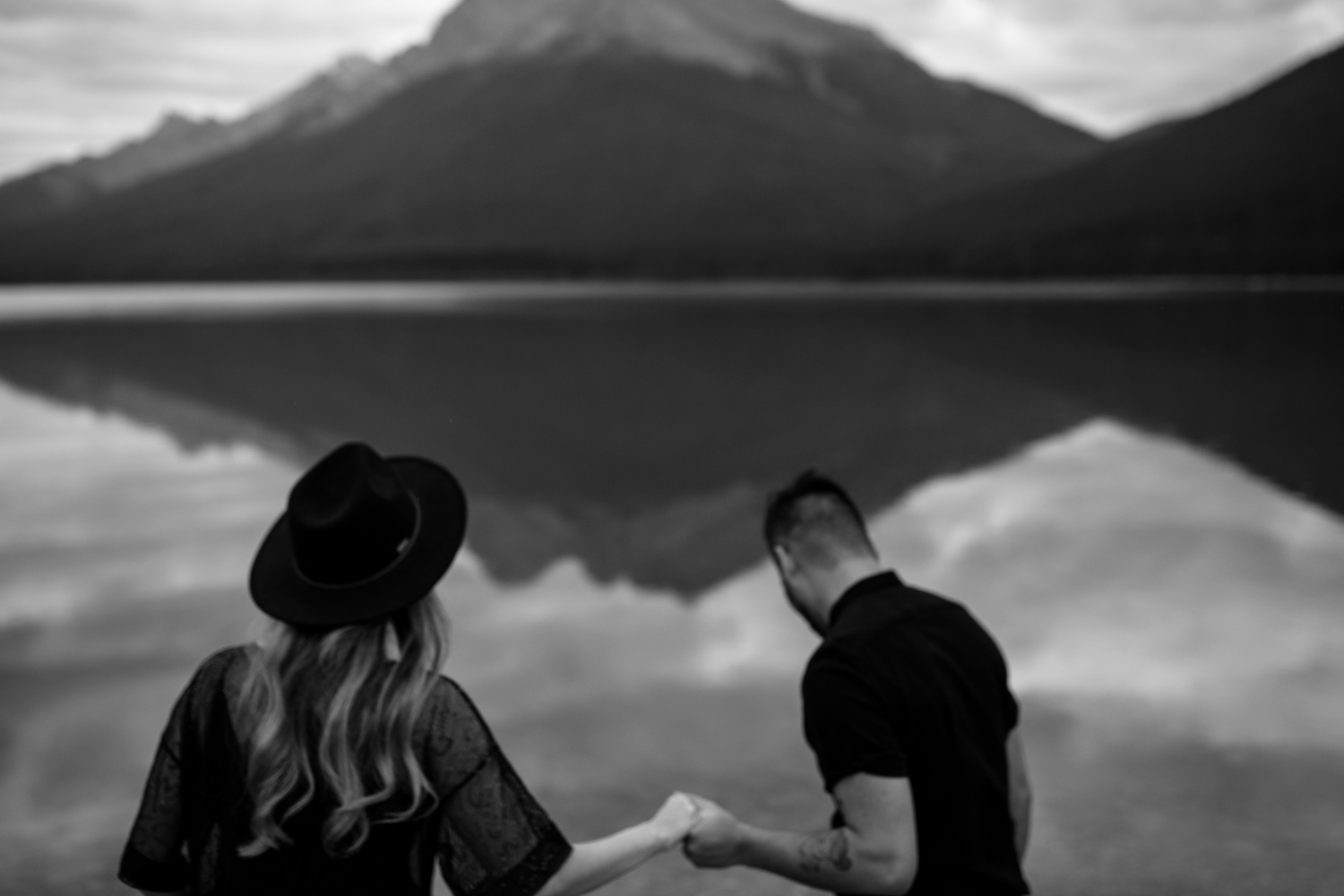 Candid Moment Husband Holds Wife's Hand Lake Moraine