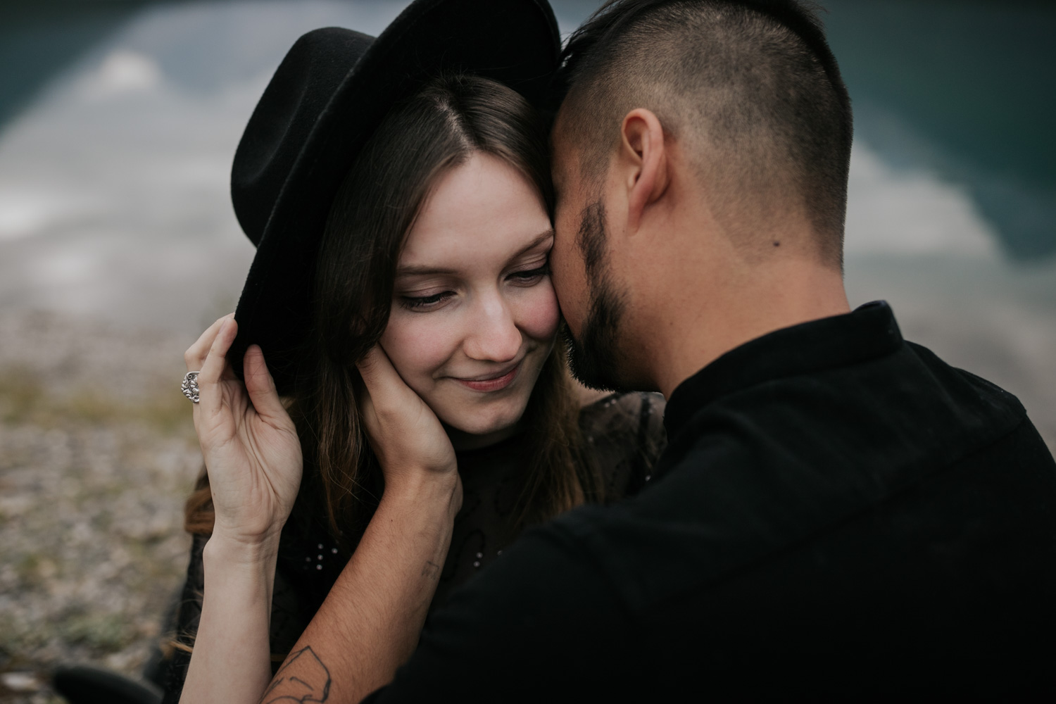 Guy Kisses Girl Wearing Black Felt Hat Vancouver Engagement Photo Shoot