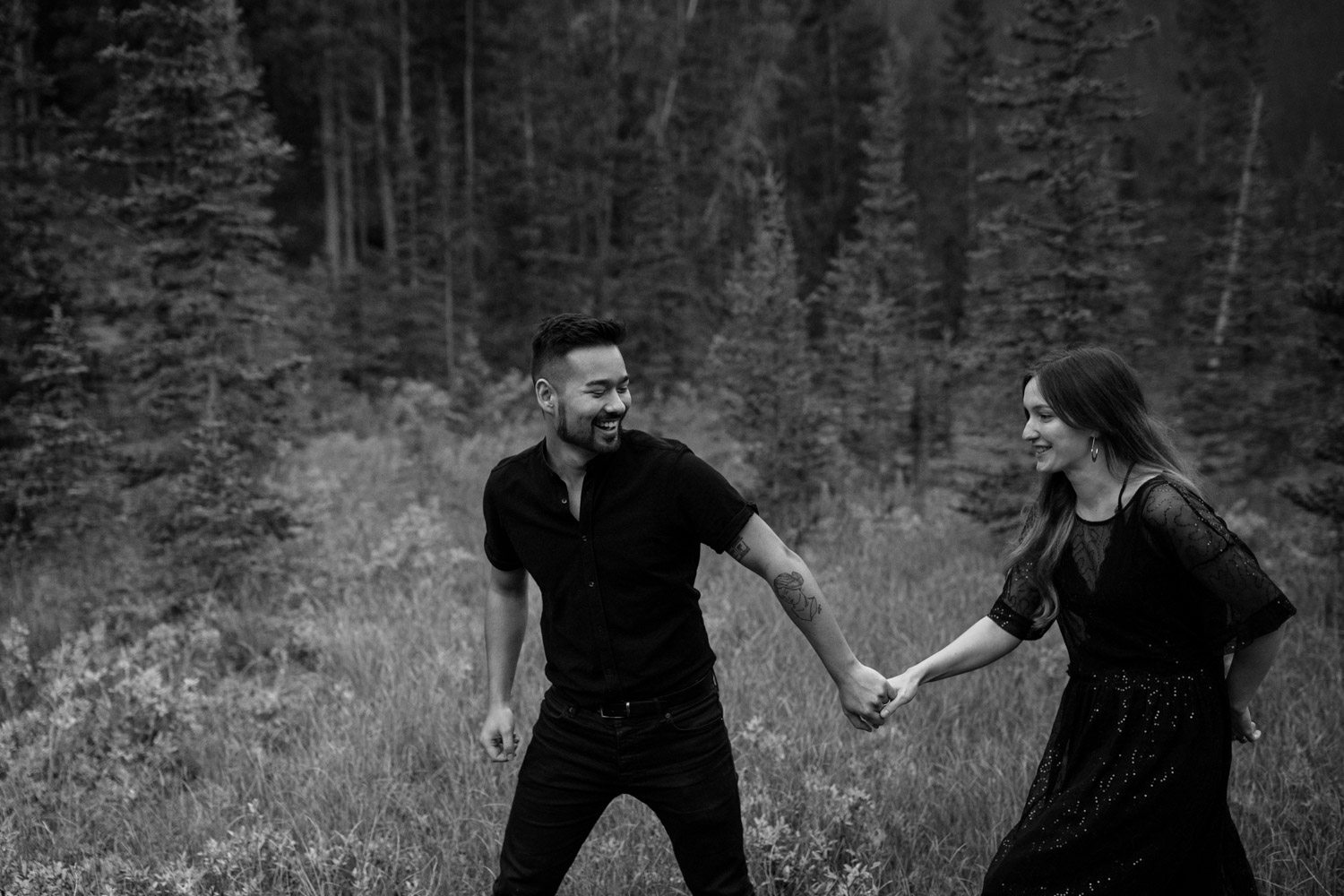 Engaged Hipster Alternative Couple Walking Laughing In BC Forest