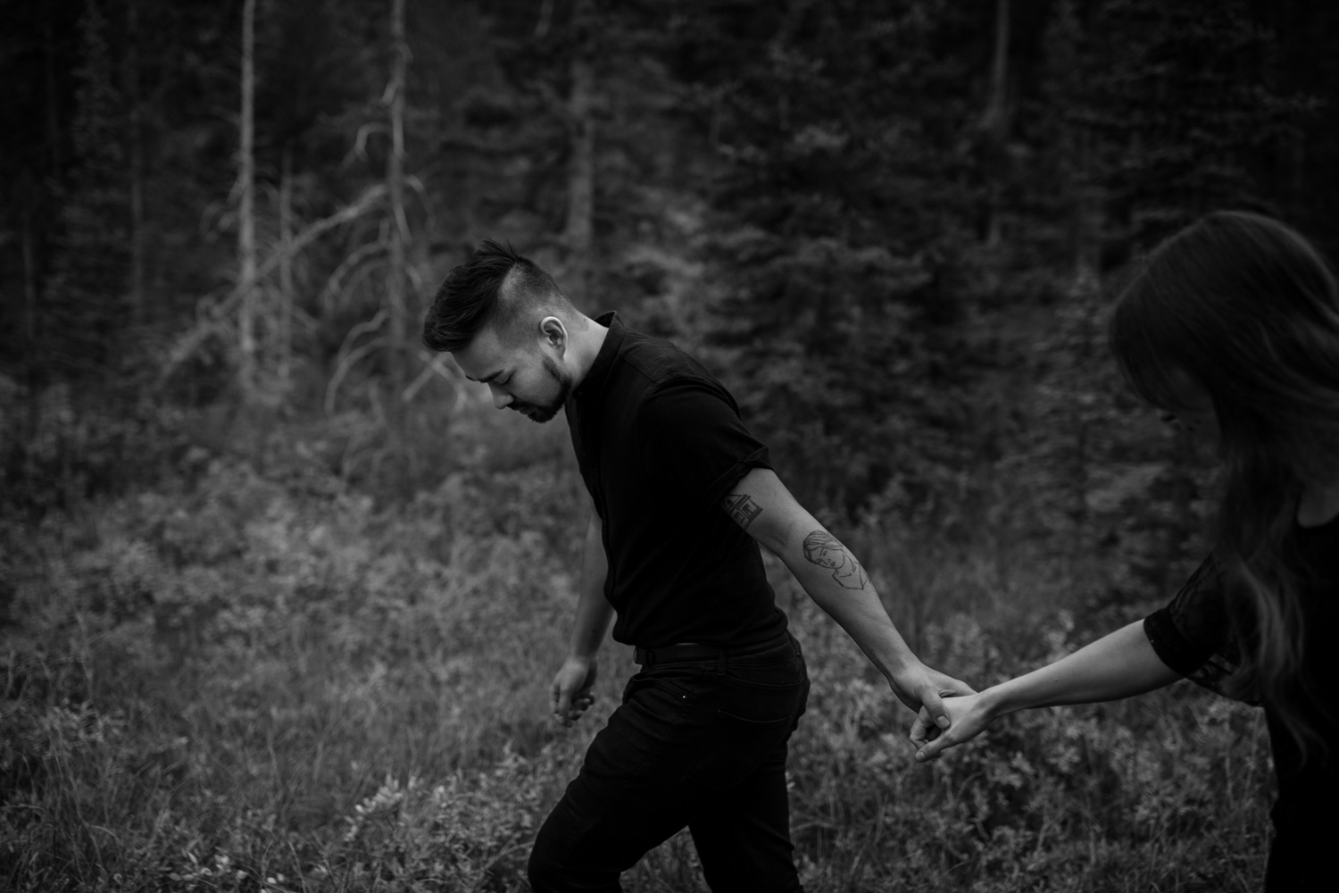 Adventurous Couple Walk Hand In Hand In Wild BC Forest