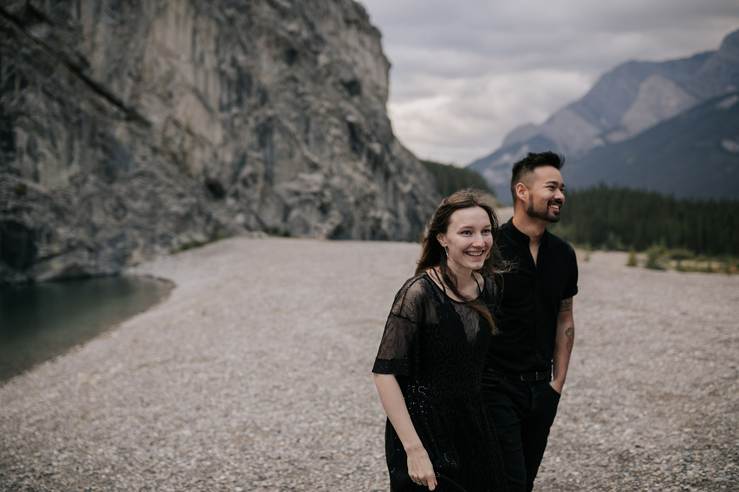 Couple Laughs And Has Fun At Turquoise Blue Lake Louise In Alberta