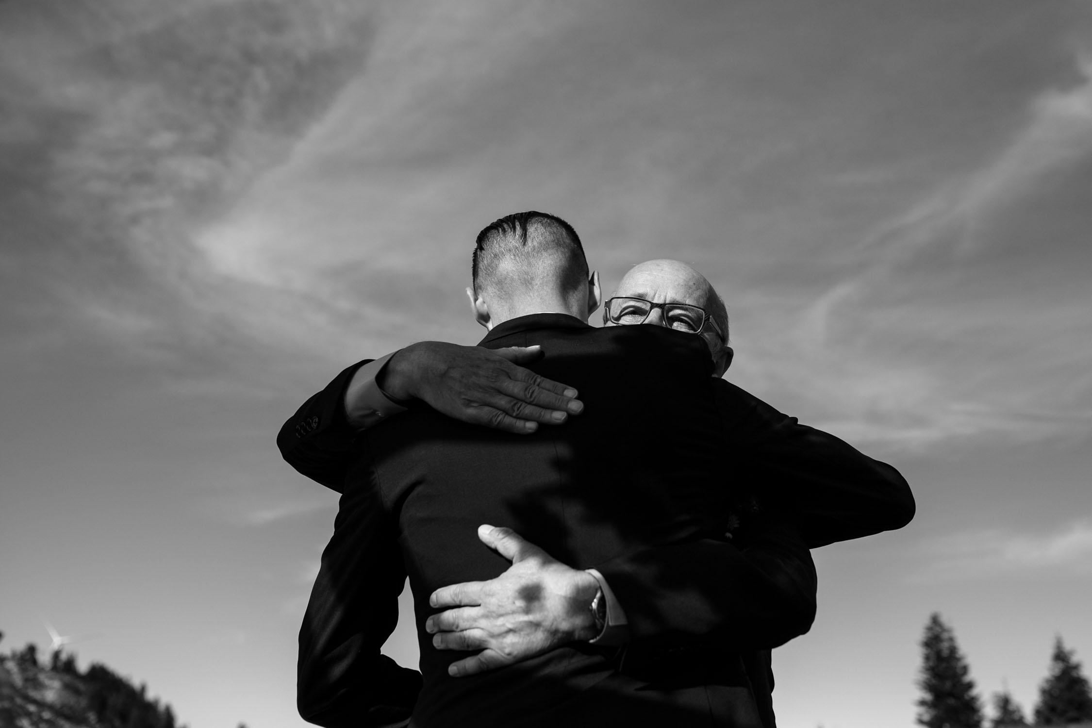 Dad Hugs Son On Wedding Day Photojournalist Wedding Photographer