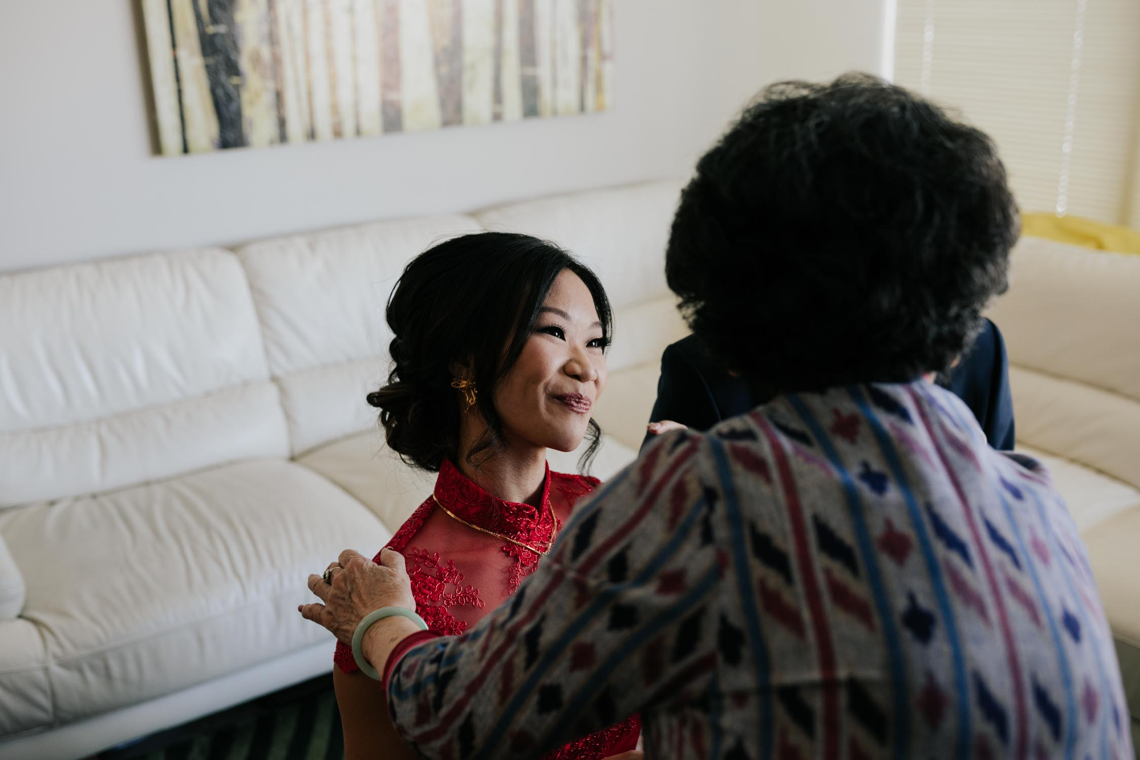 Chinese bride serves grandmother tea during tea ceremony