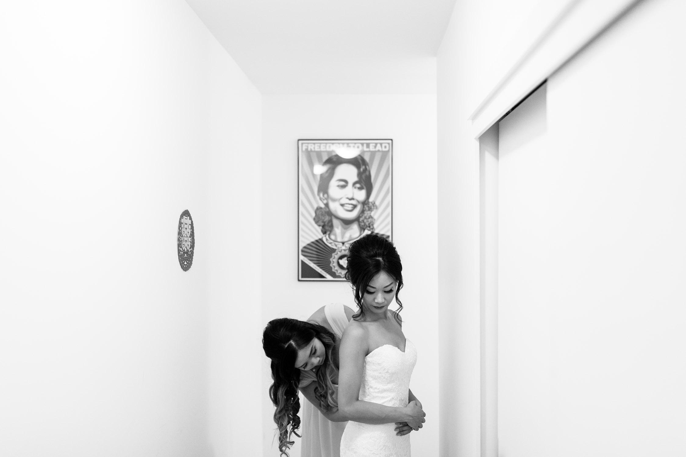 Bridesmaid helps bride to get in Mount Pleasant Loft Apartment Vancouver
