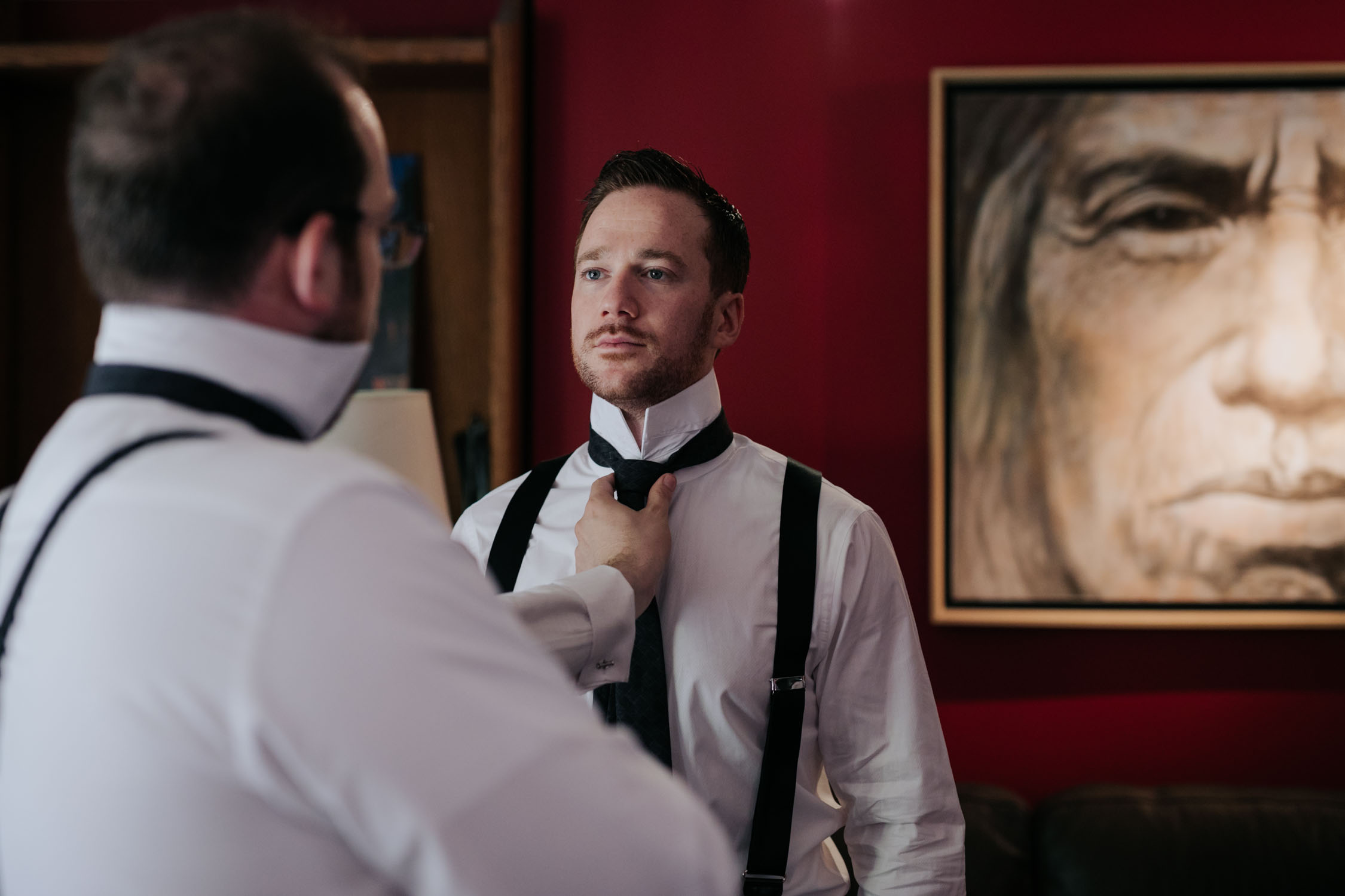 Candid and natural getting ready photographs for groom and groomsmen before Newmarket Wedding at Madsen's Greenhouse