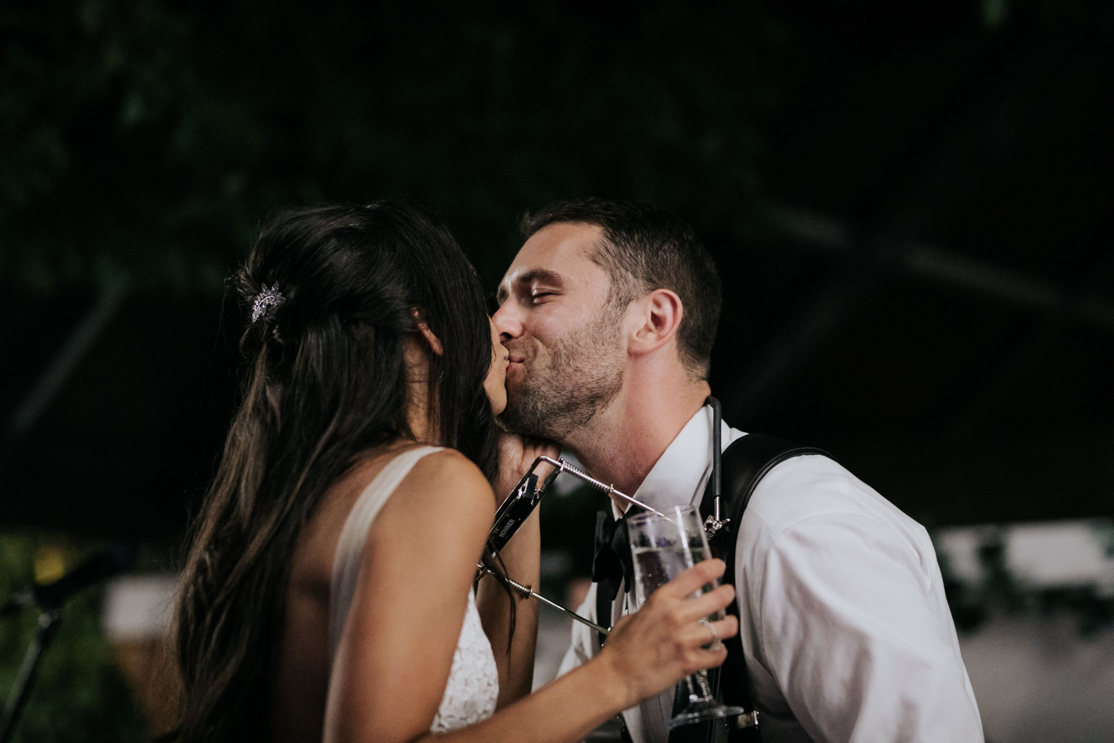 Romantic surprise as groom sings a song he wrote to his bride and does an acoustic folk music performance with guitar and harmonica Madsen's Greenhouse wedding venue in Newmarket close to Toronto