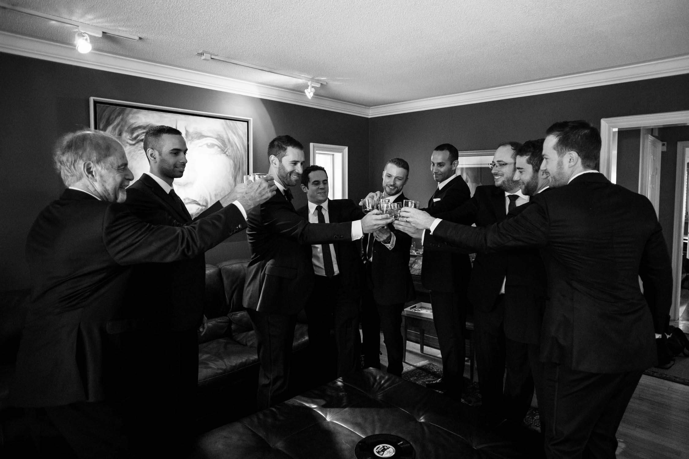 Groom and groomsmen toasting with special whiskey before Newmarket Wedding at Madsen's Greenhouse