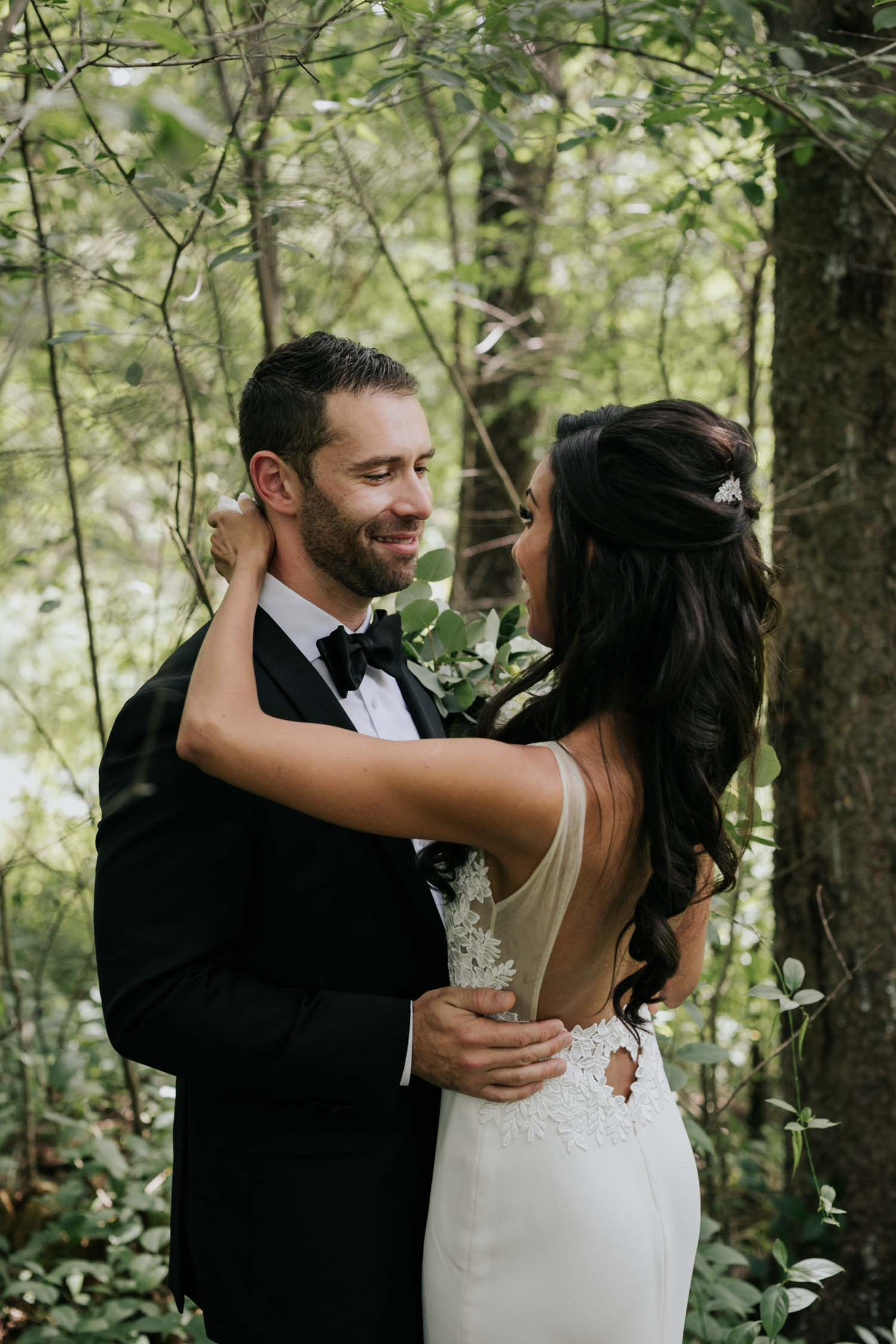 Groom crying as he sees his bride for the first time at their first look reveal in the forest at Fairy Lake Park in Newmarket before their wedding at Madsen's Greenhouse