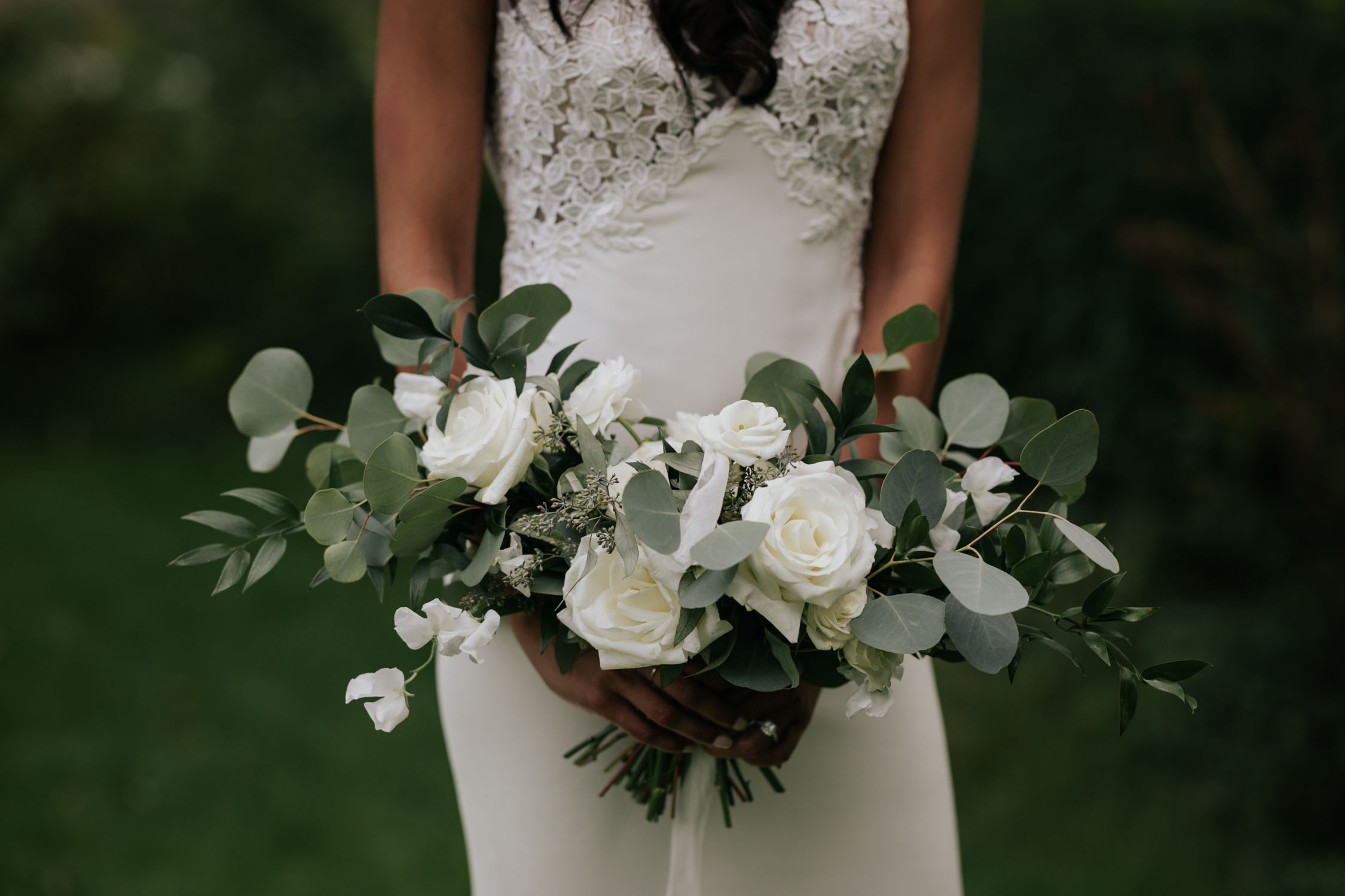 Simple and beautiful pale grey, green and white bridal bouquet Groom portrait at Madsen's Greenhouse wedding venue in Newmarket close to Toronto