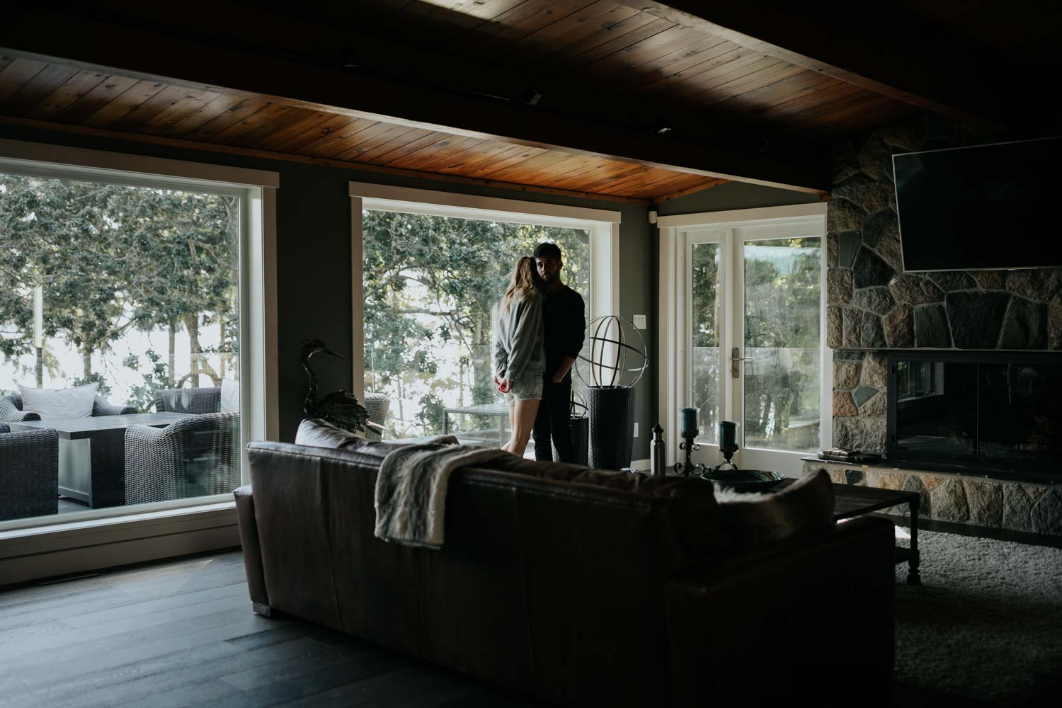 Intimate and natural home engagement session of couple in a log cabin in Nanaimo close to Gabriel Island on Vancouver Island