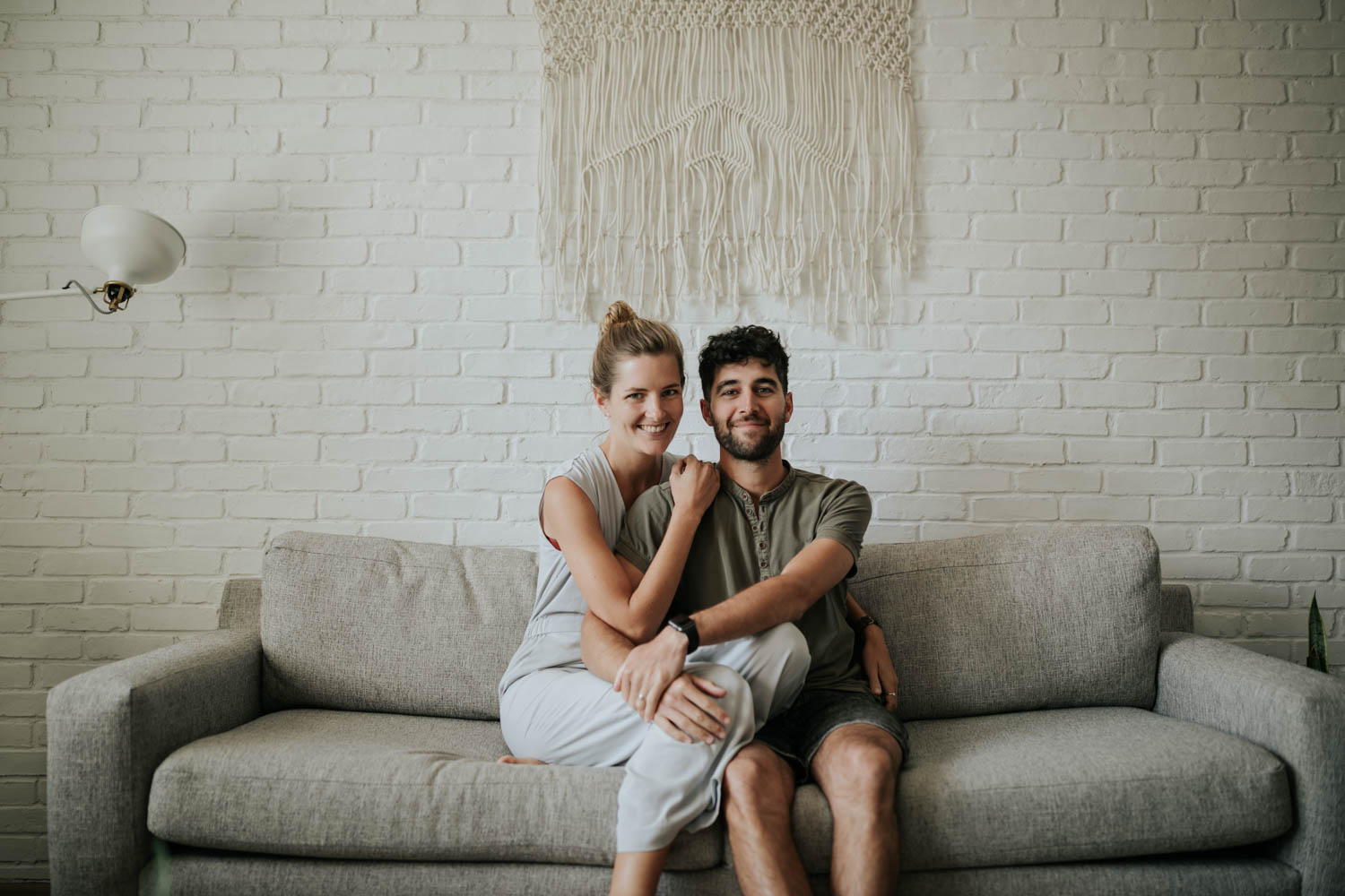 In home couple photography session on the couch with boho decor