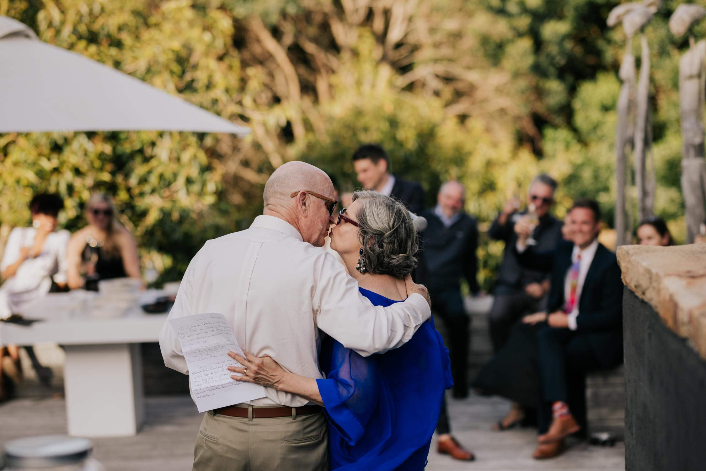 Groom's Parents Kissing During Wedding Speeches
